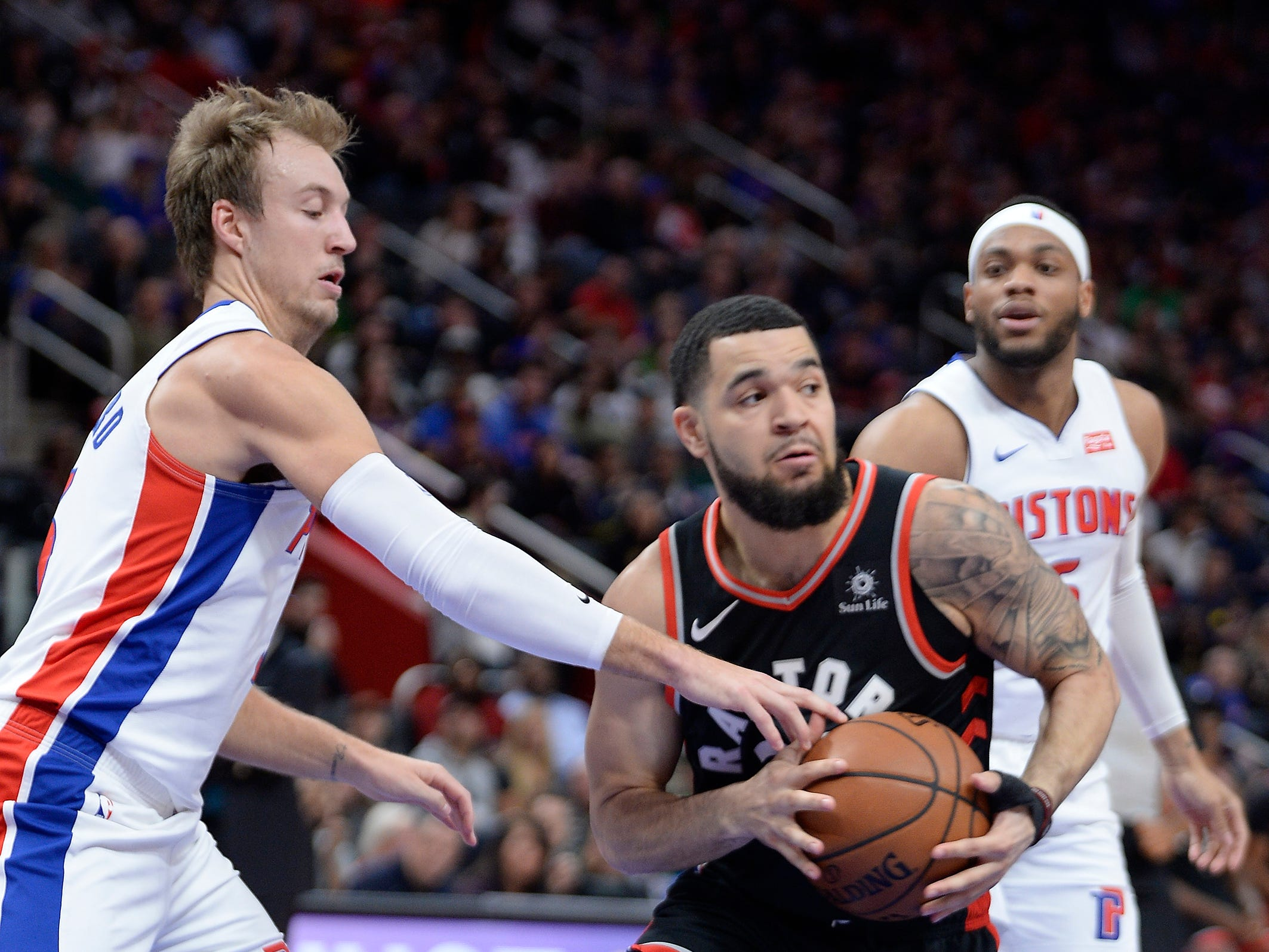 Raptors' Fred Van Vleet looks for room around Pistons' Luke Kennard in the first quarter.