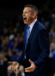 Buffalo's Nate Oats leads veteran team that won 31 games and was ranked 18 straight weeks.