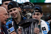 Michigan State's Matt McQuaid holds the Big Ten tournament trophy after the Spartans down the Wolverines 65-60 Sunday.