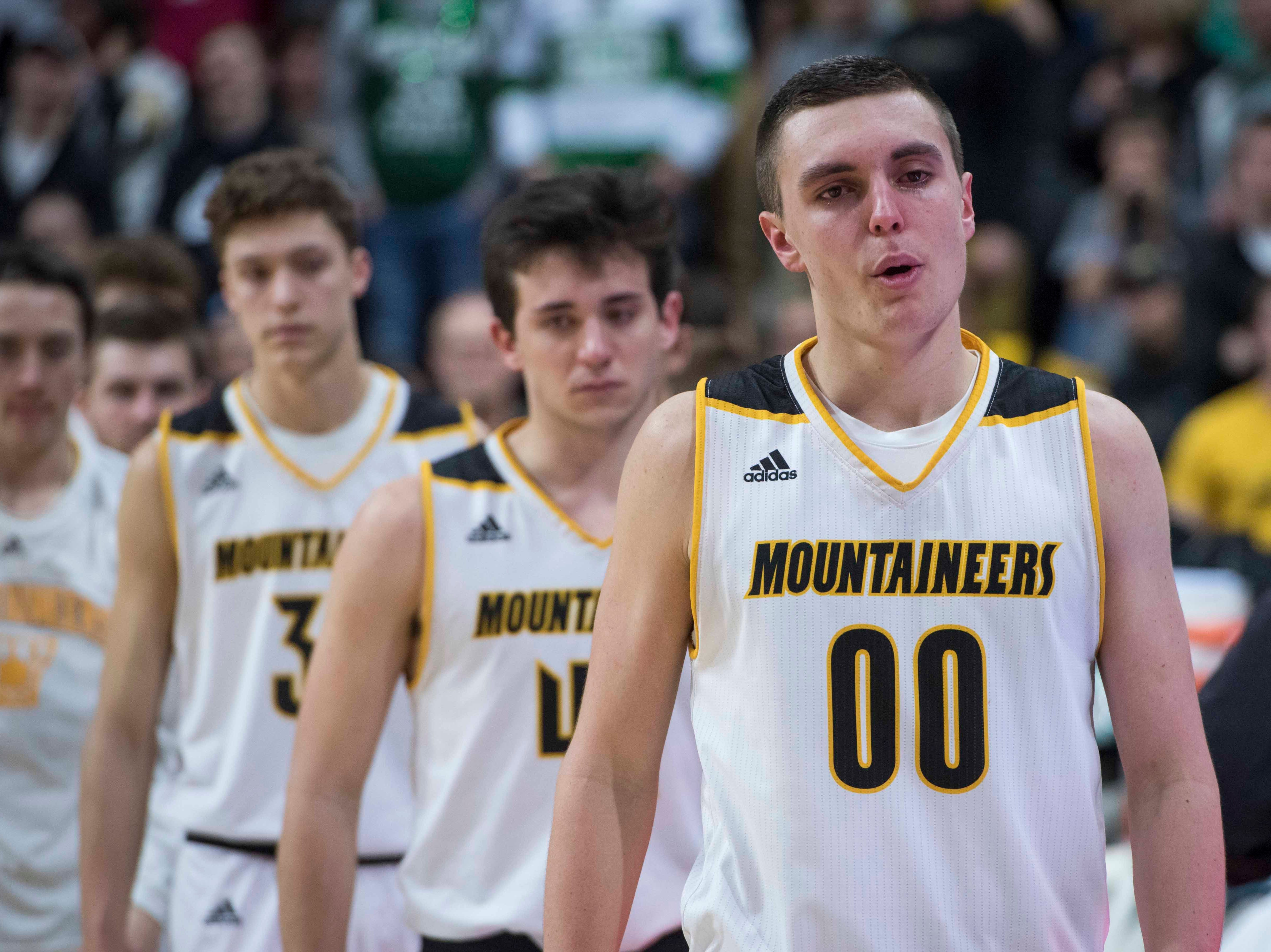 Iron Mountain's Foster Wonders looks on after his team lost the game.