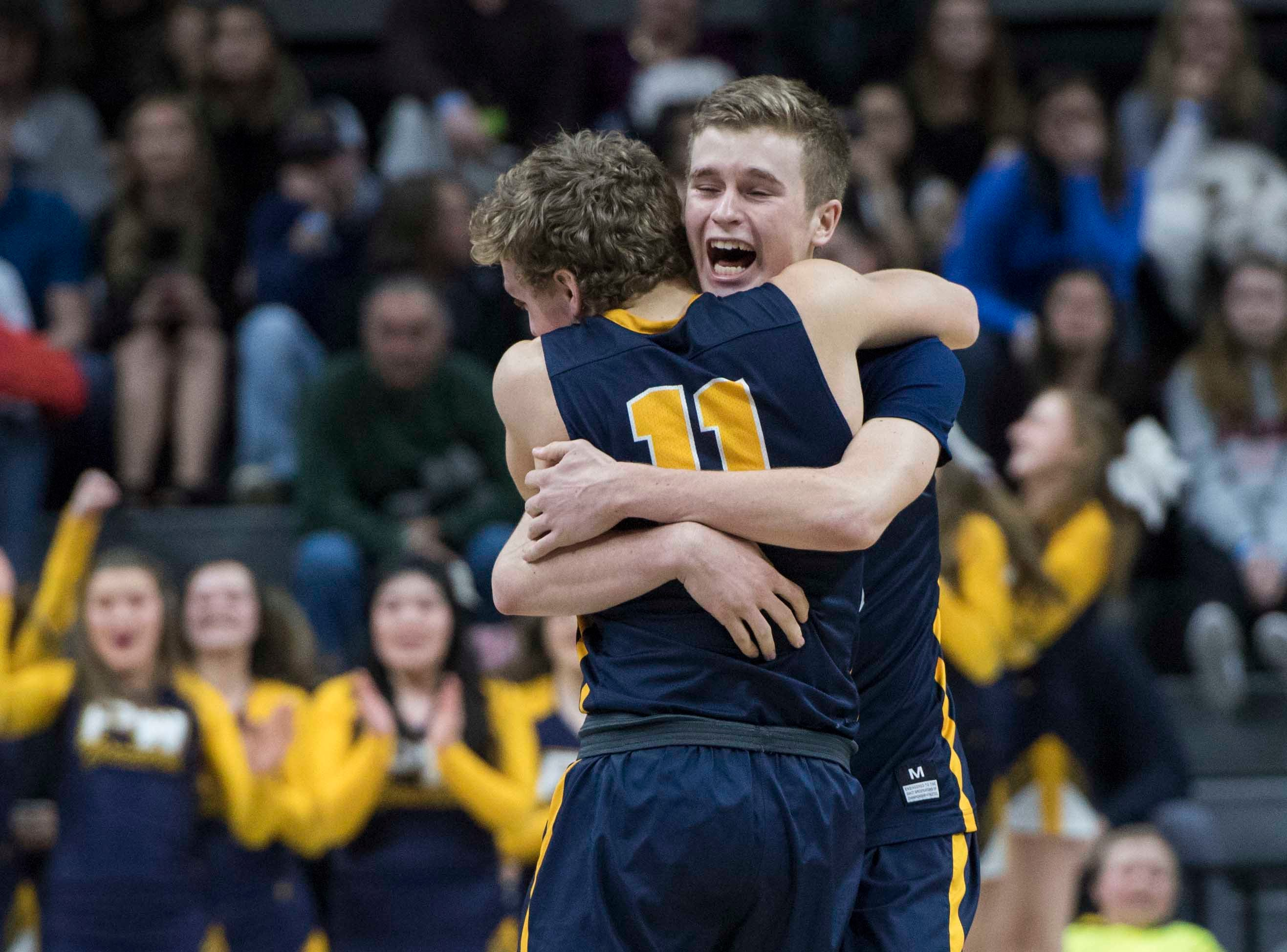 Pewamo-Westphalia's Collin Trierweiler embraces Pewamo-Westphalia's Hunter Hengesbach in the second half. *** Pewamo-Westphalia defeated Iron Mountain 53-52 in the MHSAA Div. 3 championship game at Breslin Center in East Lansing on Saturday, March 16, 2019. (Nic Antaya, Special to The Detroit News)