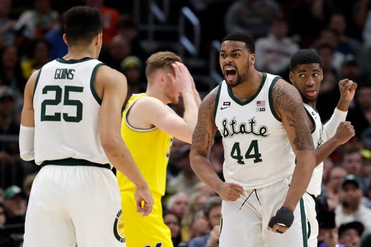 Nick Ward reacts to a basket in the first half of the Big Ten championship game against Michigan.