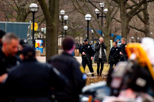 University of Michigan police officers respond with Washtenaw County Sheriff's deputies and the FBI, ATF and U.S. Border Patrol to a report of an active shooter on the University of Michigan campus near Mason Hall in Ann Arbor, Mich., Saturday, March 16, 2019.