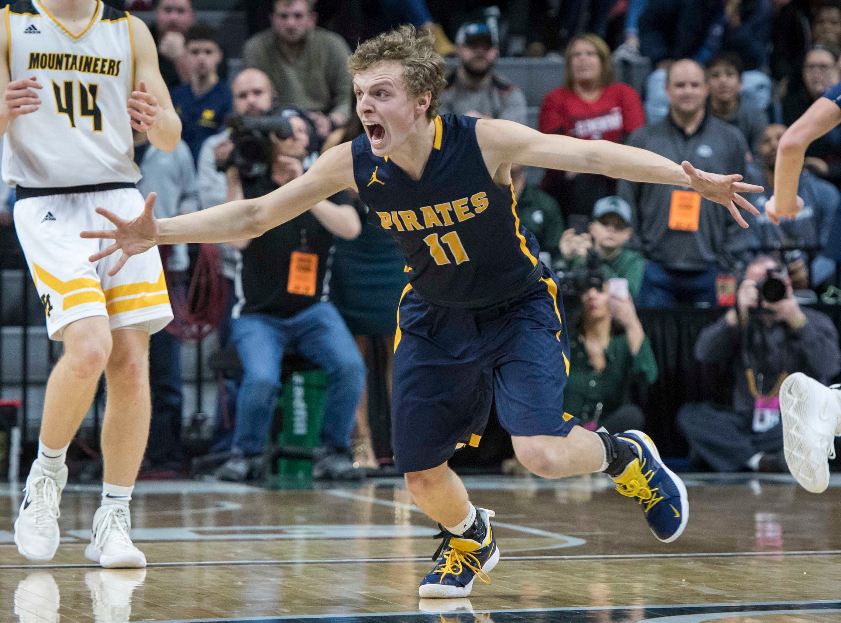 Pewamo-Westphalia's Collin Trierweiler reacts to making the game-winning point in the second half.