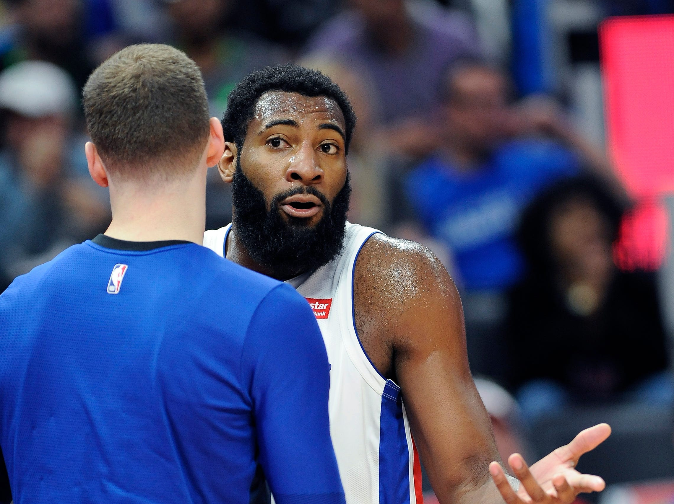 Pistons' Andre Drummond is held back by teammate Jon Leuer after a foul was called on him in the first quarter.