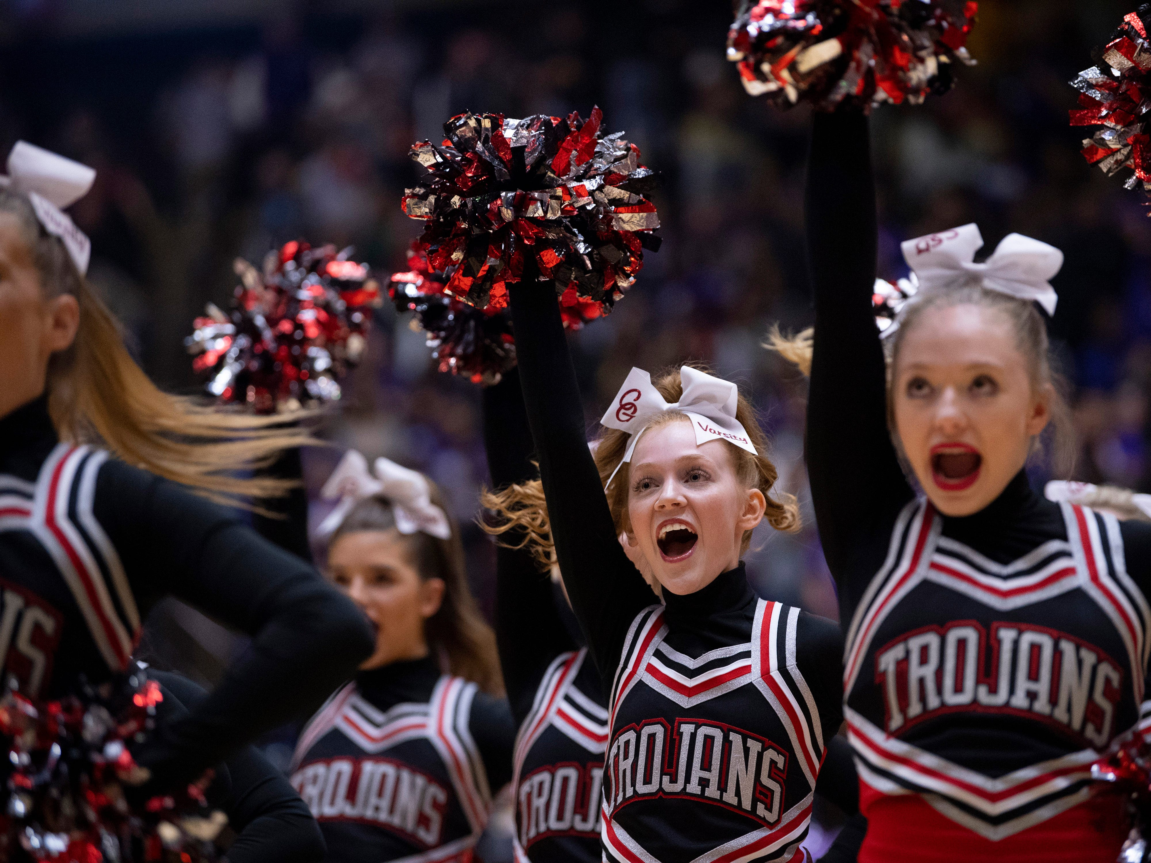 Center Grove cheerleaders pump up the fans during the 4A Boys Indiana Semi-State Basketball Tournament game against Ben Davis at the Hatchet House in Washington, Ind., Saturday afternoon.
