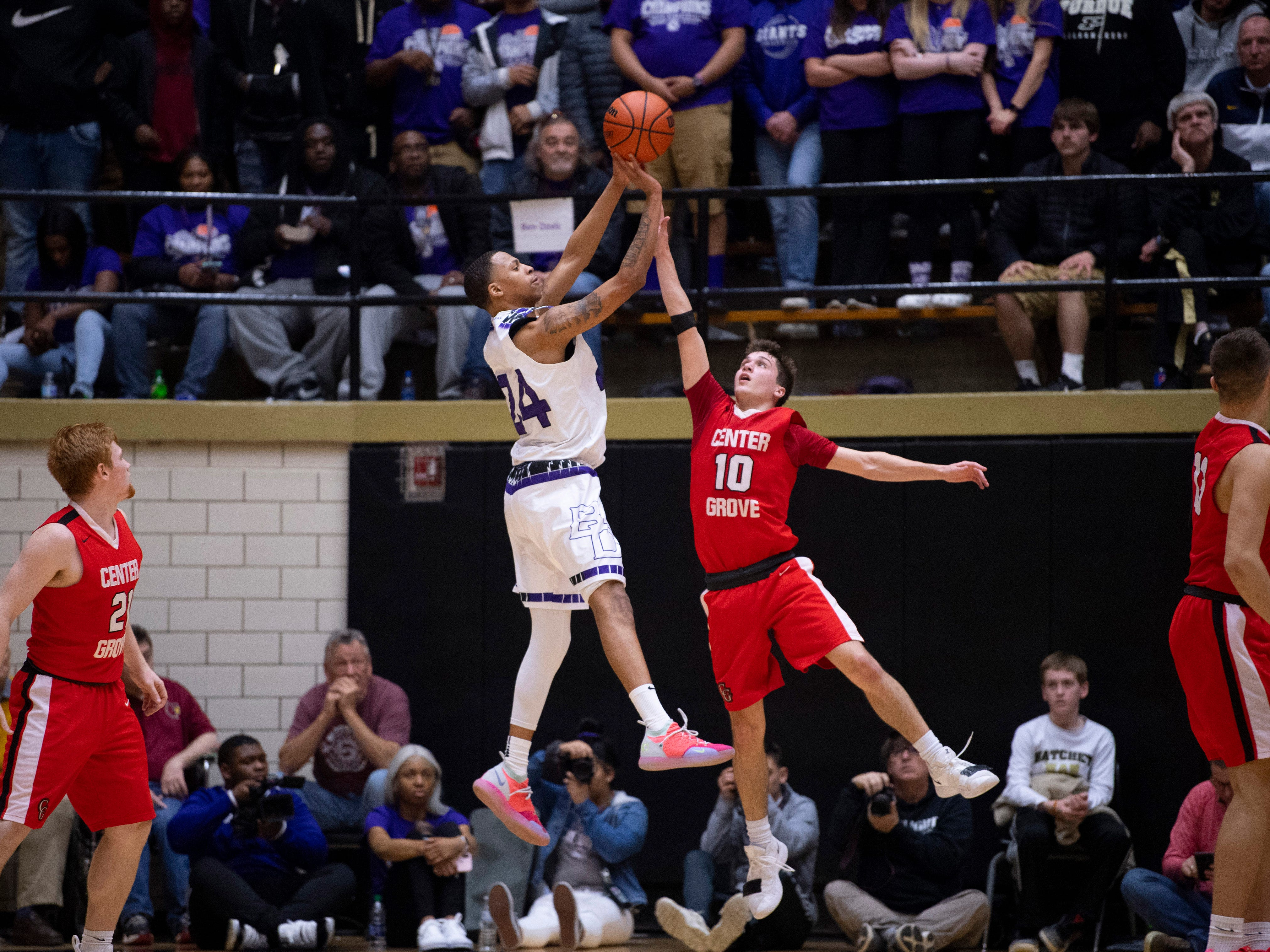 Ben Davis's Jalen Windham (24) puts up a shot over Center Grove's Spencer Piercefield (10) during the 4A Boys Indiana Semi-State Basketball Tournament at the Hatchet House in Washington, Ind., Saturday afternoon.