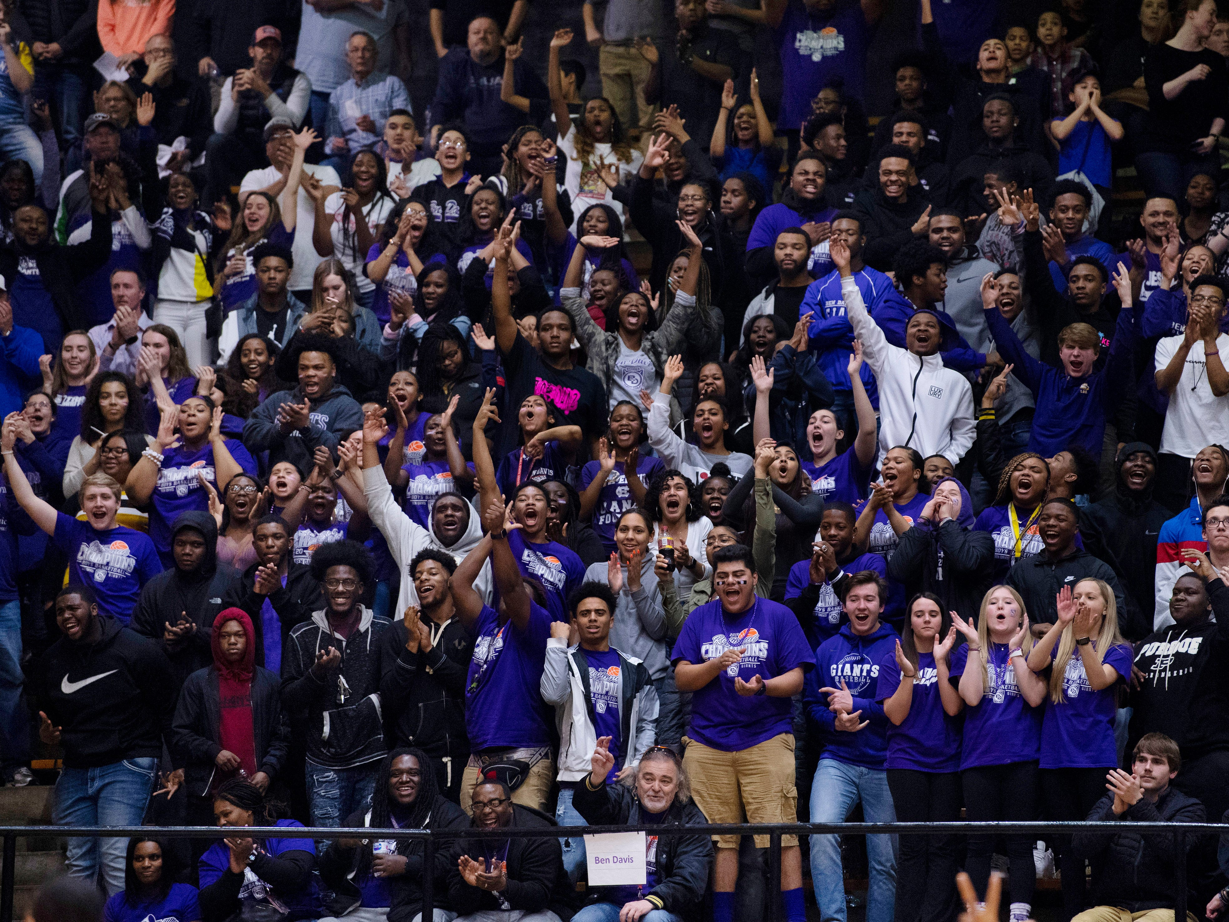 The Ben Davis fans erupt after going up by 15 points against Center Grove during the 4A Boys Indiana Semi-State Basketball Tournament at the Hatchet House in Washington, Ind., Saturday afternoon.