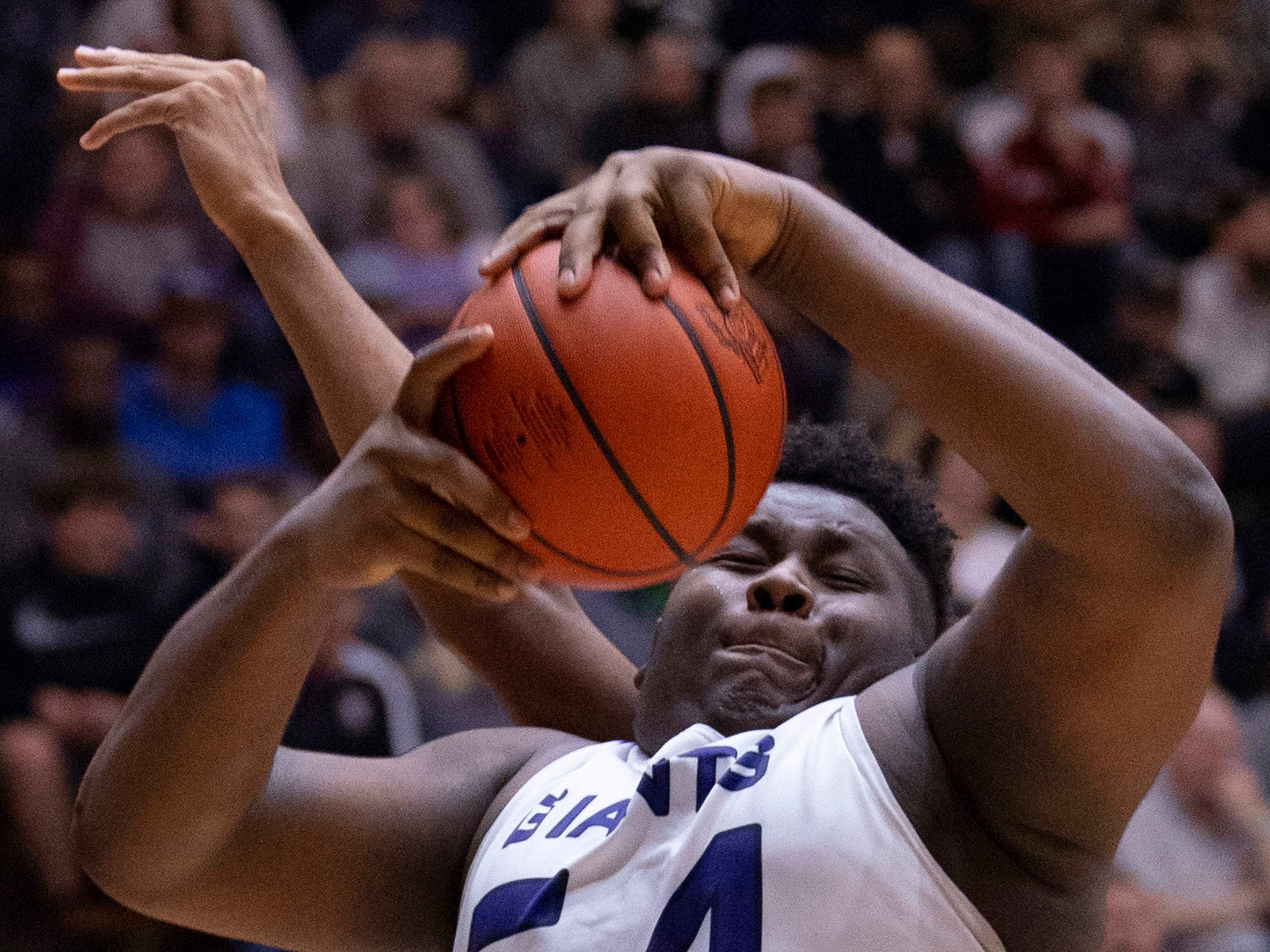 Ben Davis's Dawand Jones (54) pulls down another rebound against Center Grove during the 4A Boys Indiana Semi-State Basketball Tournament at the Hatchet House in Washington, Ind., Saturday afternoon.