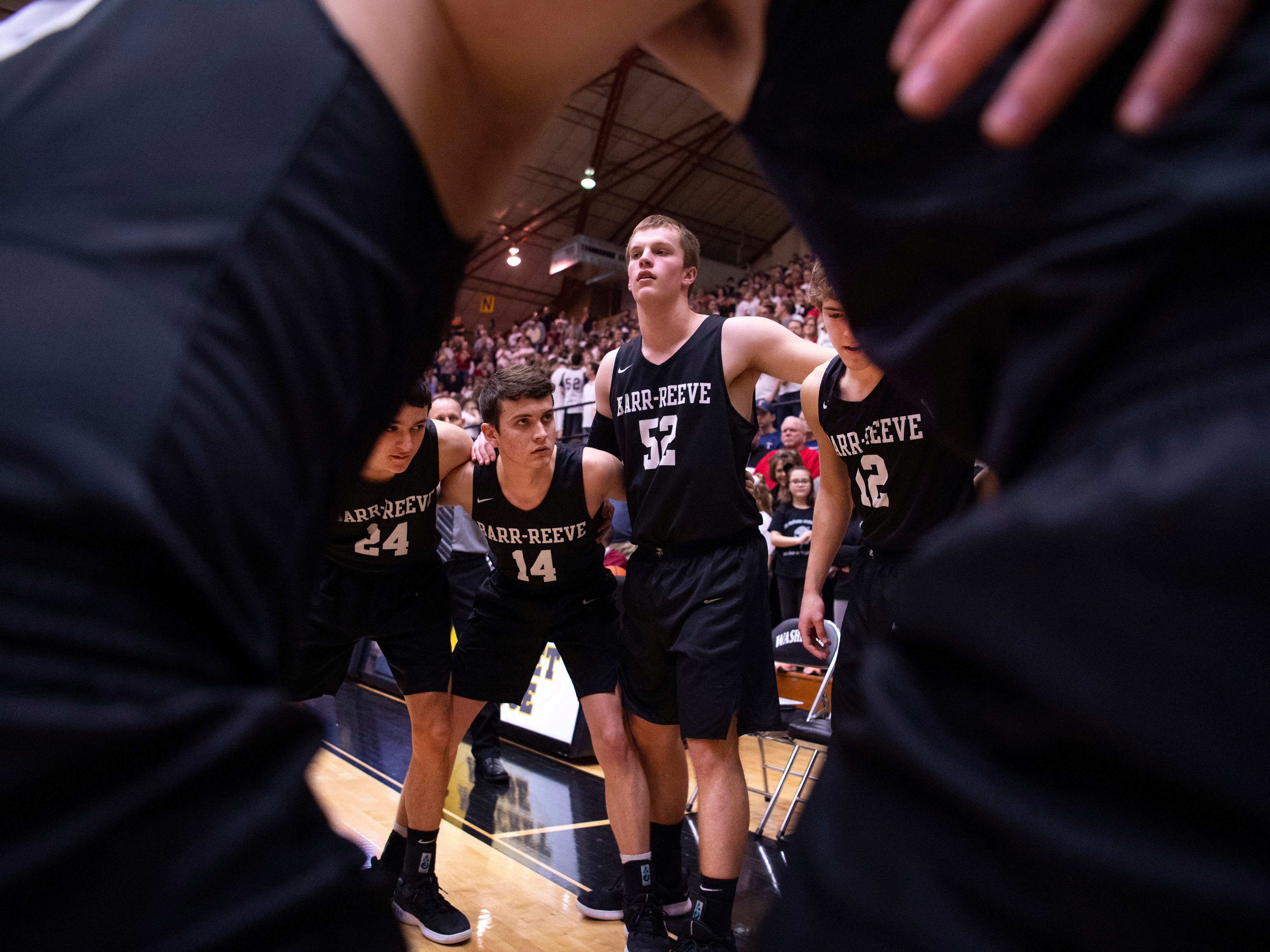 Barr-Reeve circles up before the start of their game against Bloomfield during the 1A Boys Indiana Semi-State Basketball Tournament at the Hatchet House in Washington, Ind., Saturday afternoon.