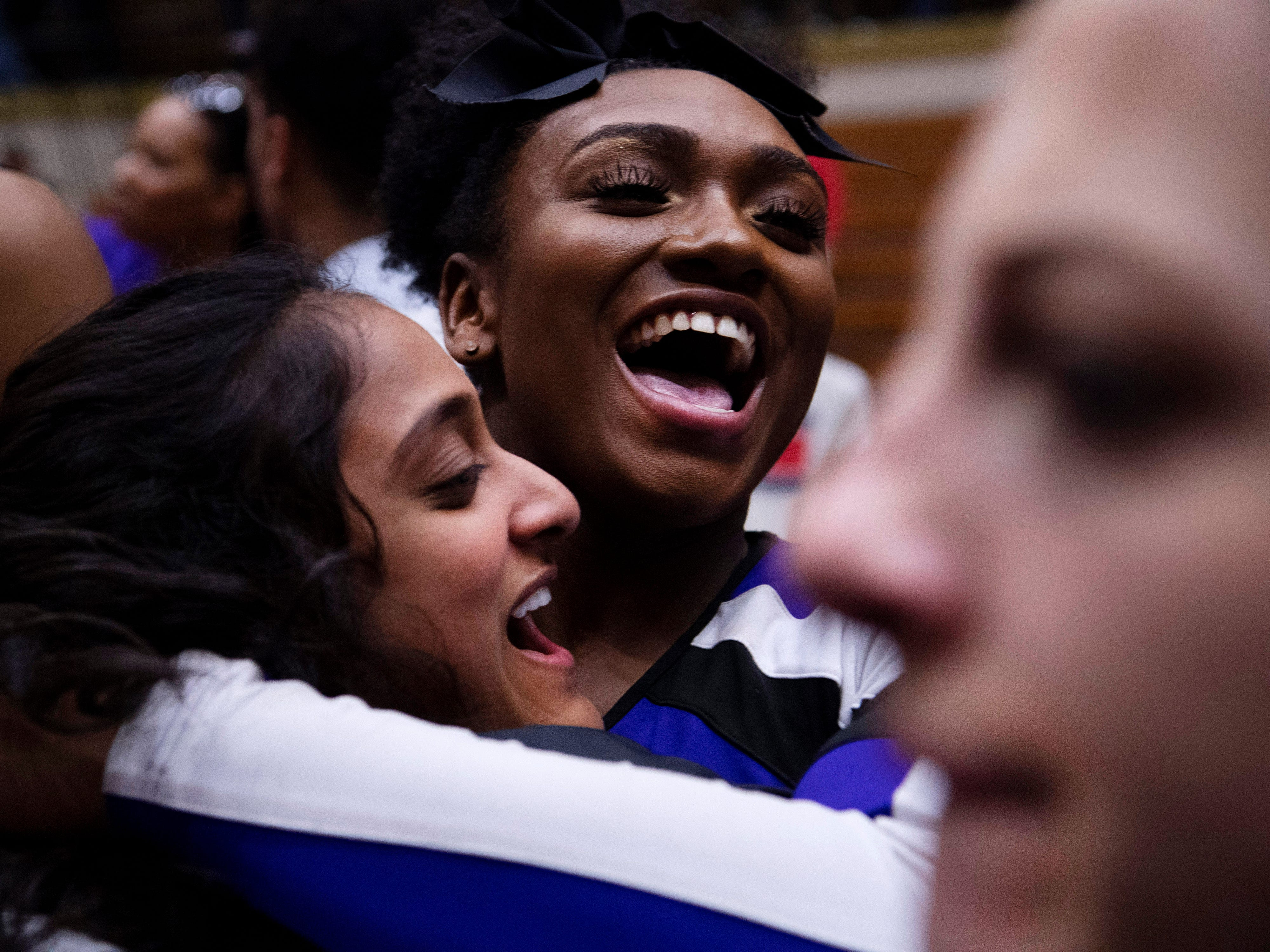 Ben Davis cheerleader Ashley Akin, top, celebrates with the students on the court after beating Center Grove in the 4A Boys Indiana Semi-State Basketball Tournament at the Hatchet House in Washington, Ind., Saturday afternoon. Ben Davis beat Central Grove to advance to next week's state championship.