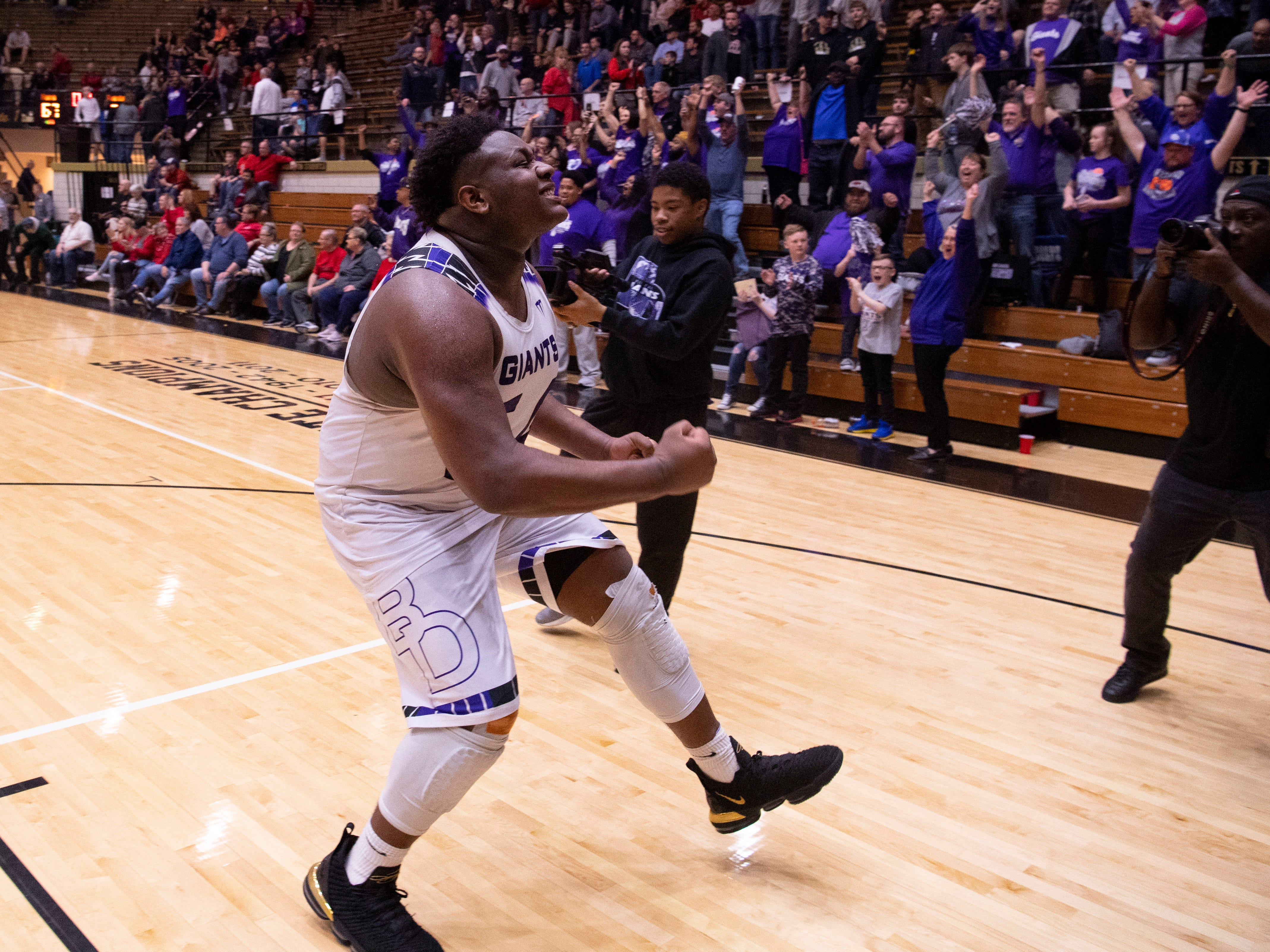 Ben Davis's Dawand Jones (54) celebrates on his way to the student section after beating Center Grove in the 4A Boys Indiana Semi-State Basketball Tournament at the Hatchet House in Washington, Ind., Saturday afternoon.