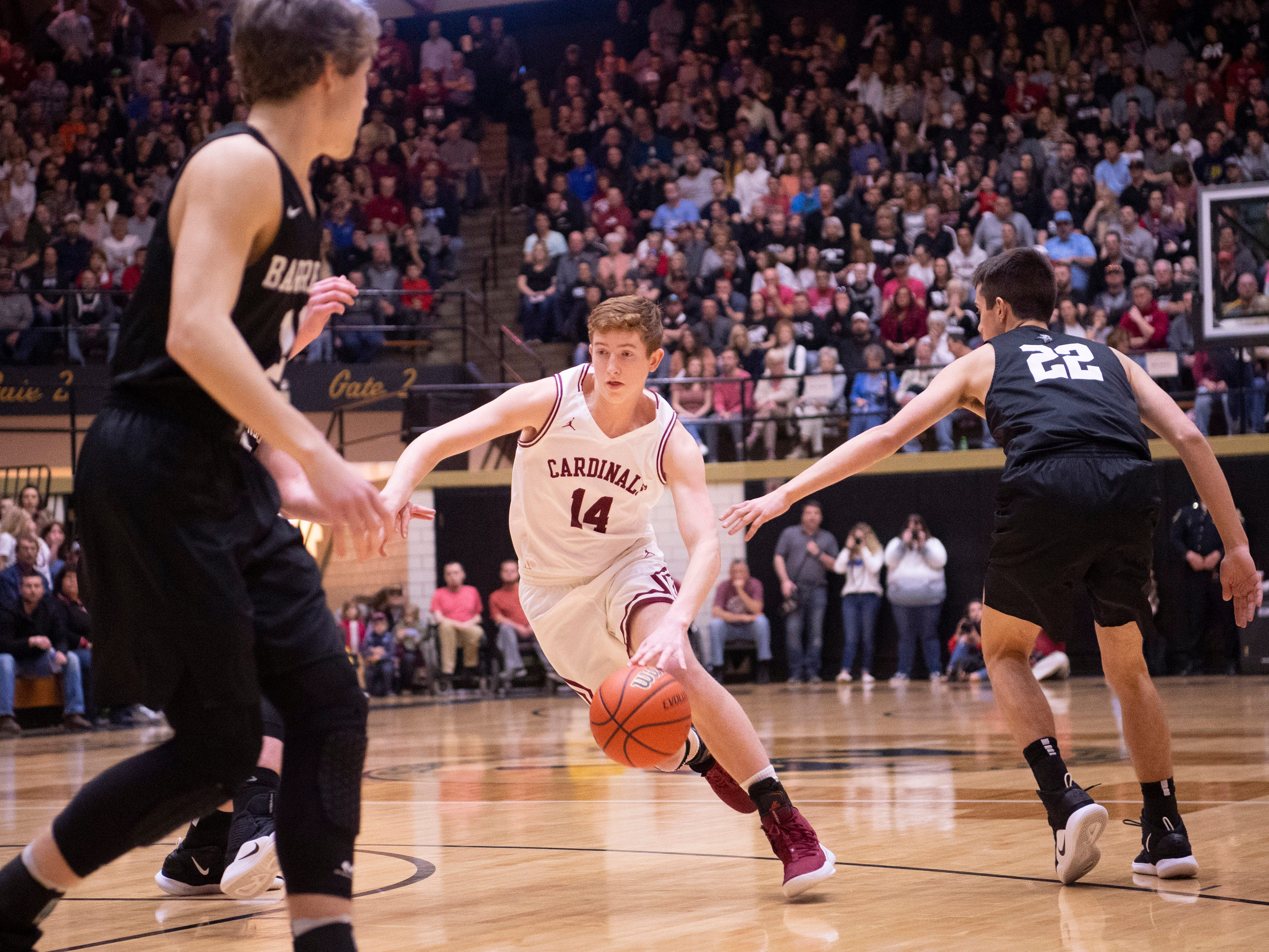 Bloomfield's Andrew Shelton (14) drives past Barr-Reeve's Brycen Graber (22) during the 1A Boys Indiana Semi-State Basketball Tournament at the Hatchet House in Washington, Ind., Saturday afternoon.