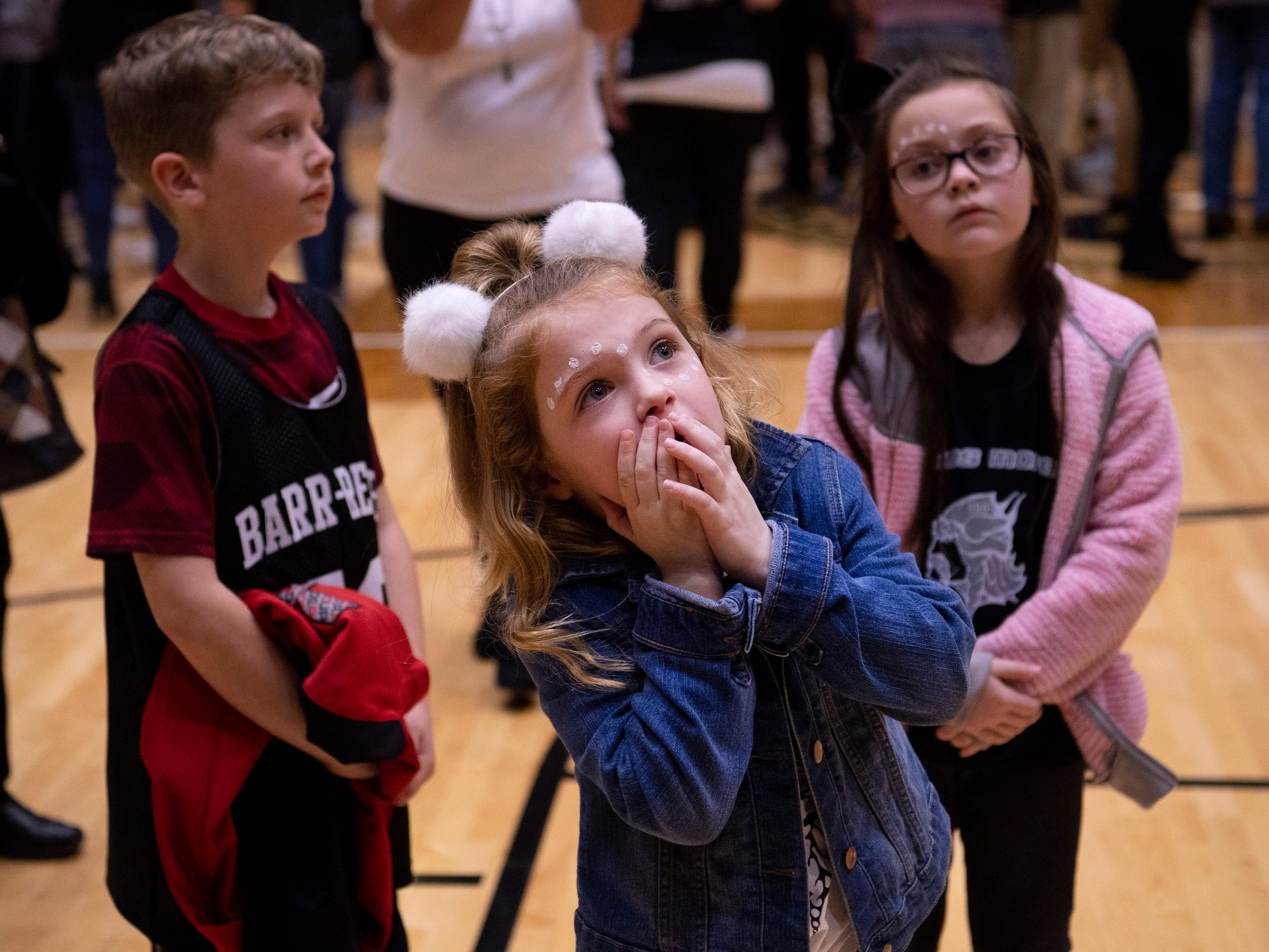 Clair Doyle, 6, watches the net being cut down after the 1A Boys Indiana Semi-State Basketball Tournament at the Hatchet House in Washington, Ind., Saturday afternoon. Barr-Reeve beat Bloomfield to advance to state next week.