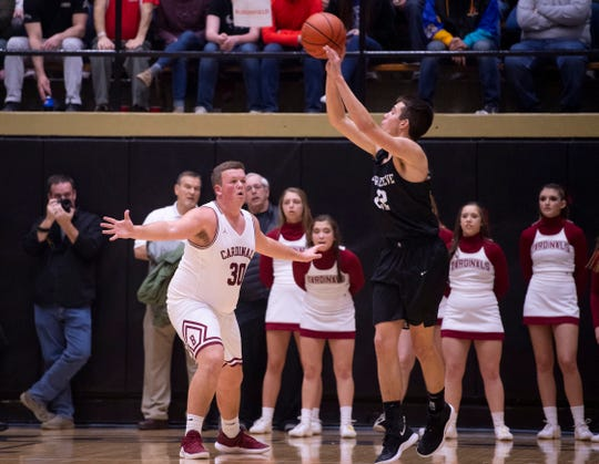 Barr-Reeve's Brycen Graber (22) shoots over Bloomfield's Graysen Medina (30) during the 1A Boys Indiana Semi-State Basketball Tournament at the Hatchet House in Washington, Ind., Saturday afternoon.