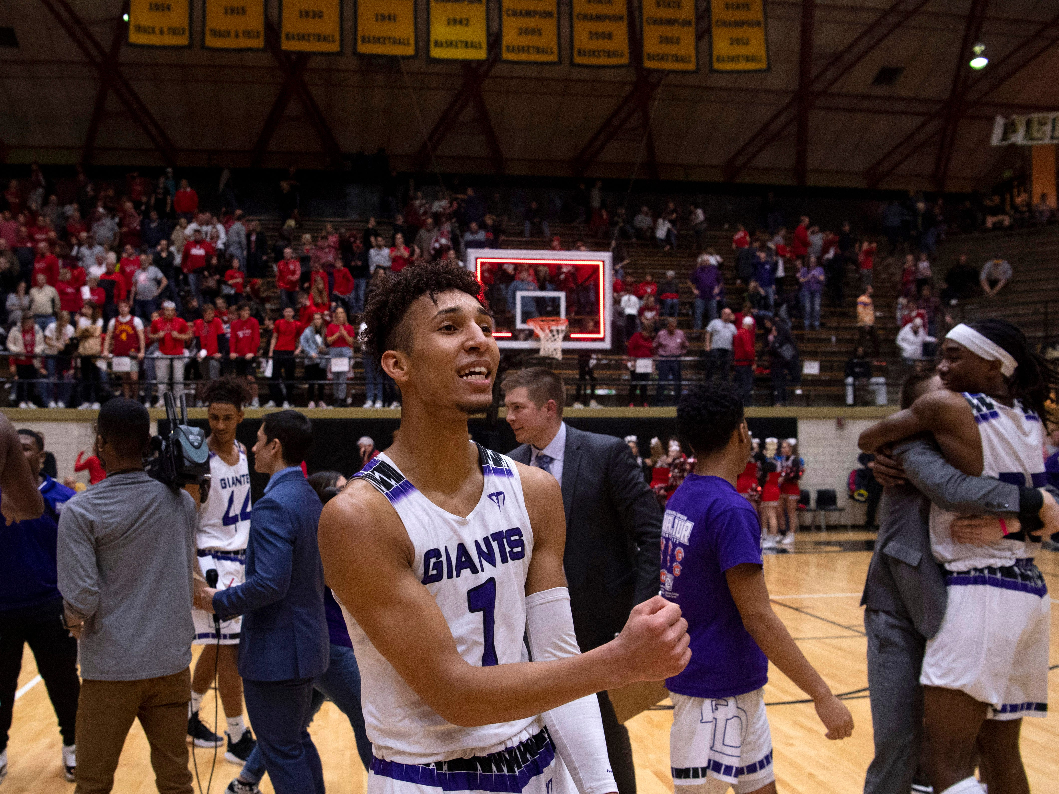 Ben Davis's Tyreese Nibbs (1) celebrates moments after beating Center Grove and advancing to state at the 4A Boys Indiana Semi-State Basketball Tournament at the Hatchet House in Washington, Ind., Saturday afternoon.