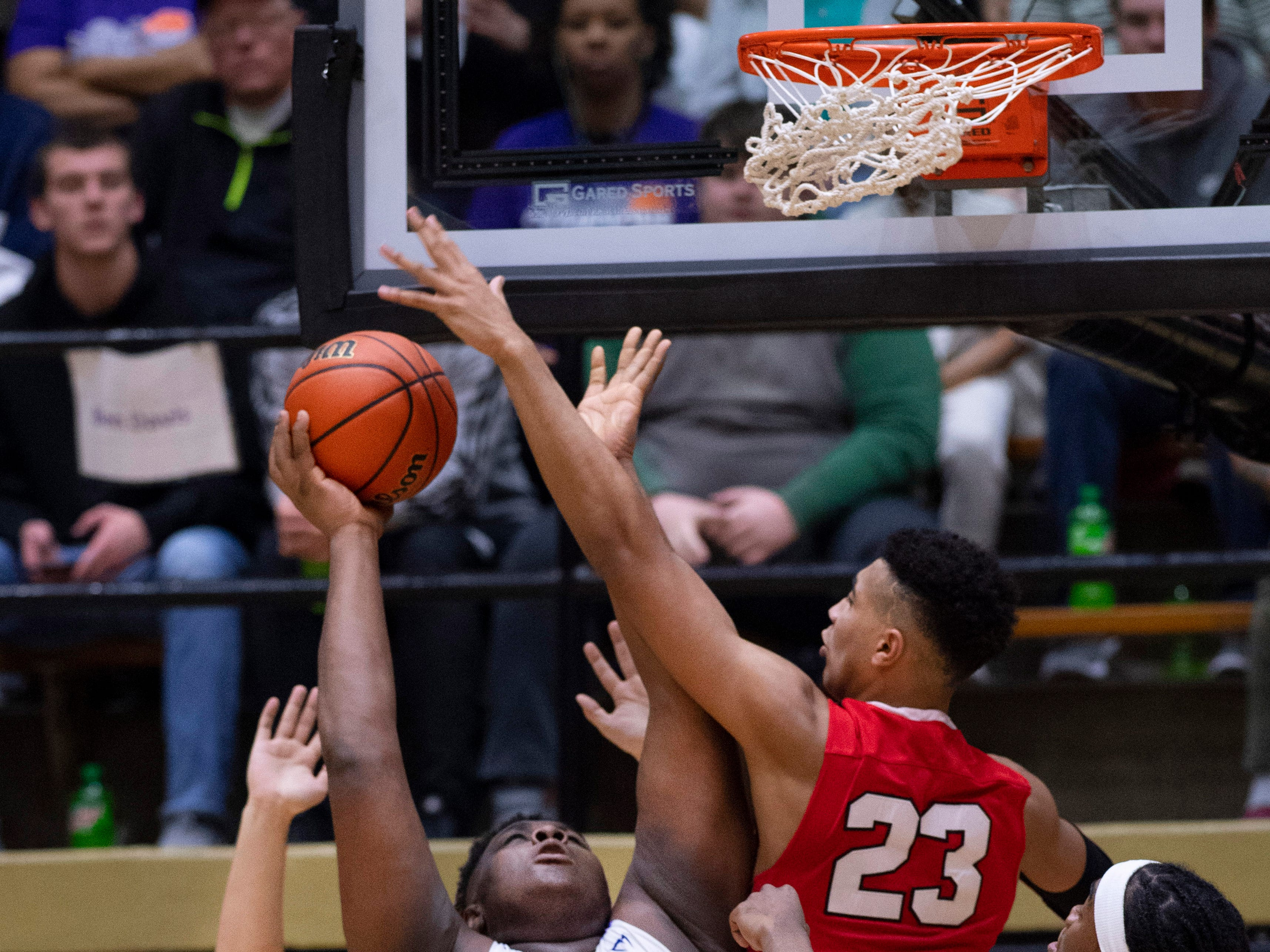 Ben Davis's Dawand Jones (54) is defended by Center Grove's Trayce Jackson-Davis (23) during the 4A Boys Indiana Semi-State Basketball Tournament at the Hatchet House in Washington, Ind., Saturday afternoon.