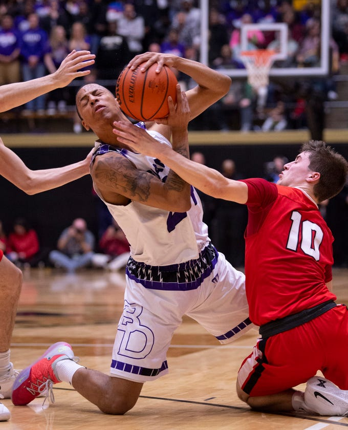 Ben Davis's Jalen Windham (24) is pressured by Center Grove's Spencer Piercefield (10) during the 4A Boys Indiana Semi-State Basketball Tournament at the Hatchet House in Washington, Ind., Saturday afternoon.