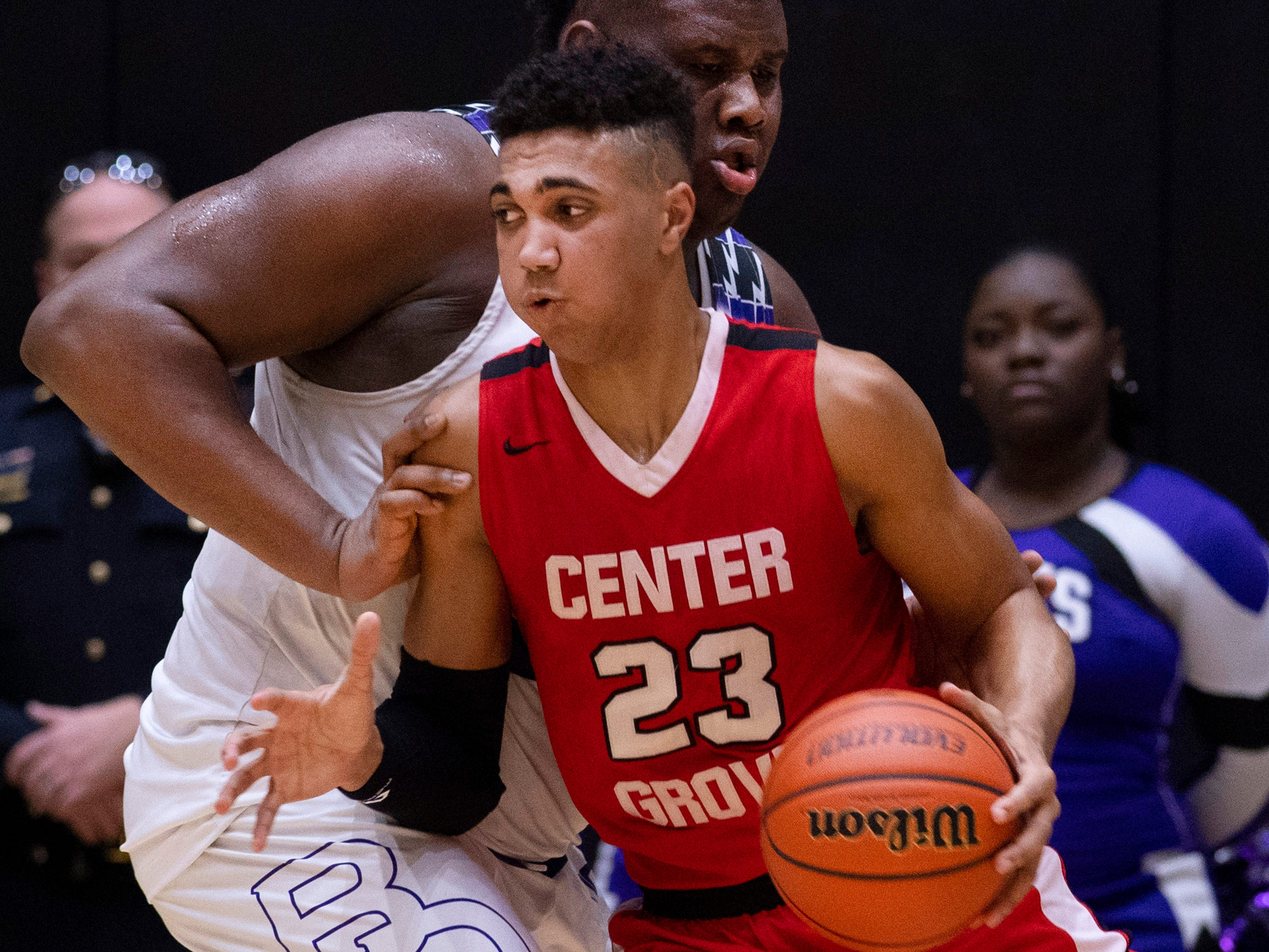 Center Grove's Trayce Jackson-Davis (23) attempts to move through the paint against Ben Davis's Dawand Jones (54) during the 4A Boys Indiana Semi-State Basketball Tournament at the Hatchet House in Washington, Ind., Saturday afternoon.