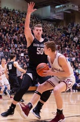 Barr-Reeve's Keegan O'Neill (50) stops Bloomfield's Andrew Shelton (14) during the 1A Boys Indiana Semi-State Basketball Tournament at the Hatchet House in Washington, Ind., Saturday afternoon.