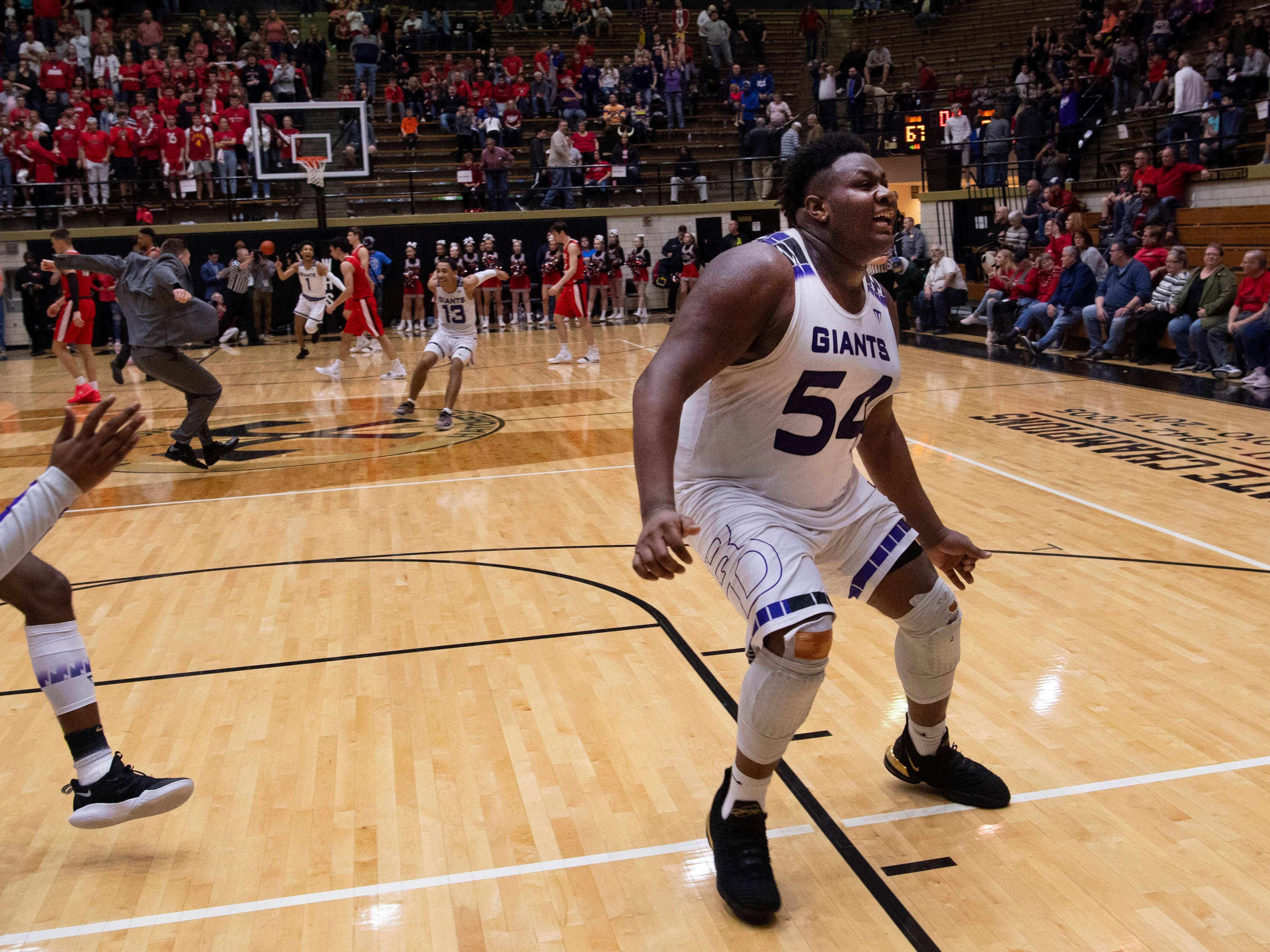 Ben Davis's Dawand Jones (54) celebrates moments after beating Center Grove and advancing to state at the 4A Boys Indiana Semi-State Basketball Tournament at the Hatchet House in Washington, Ind., Saturday afternoon.