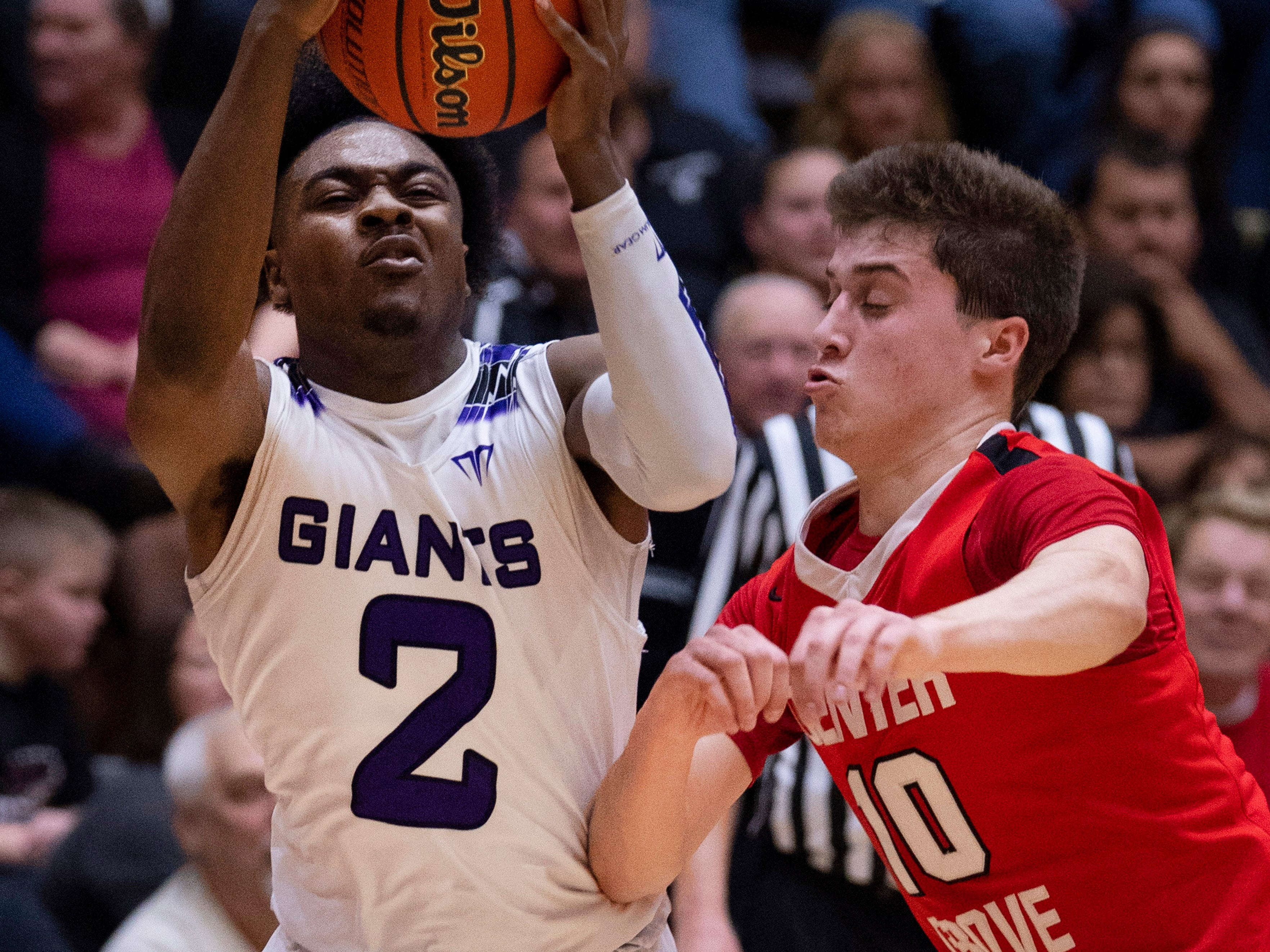 Ben Davis's Cameron Maul (2) grabs a long rebound ahead of Center Grove's Spencer Piercefield (10) during the 4A Boys Indiana Semi-State Basketball Tournament at the Hatchet House in Washington, Ind., Saturday afternoon.