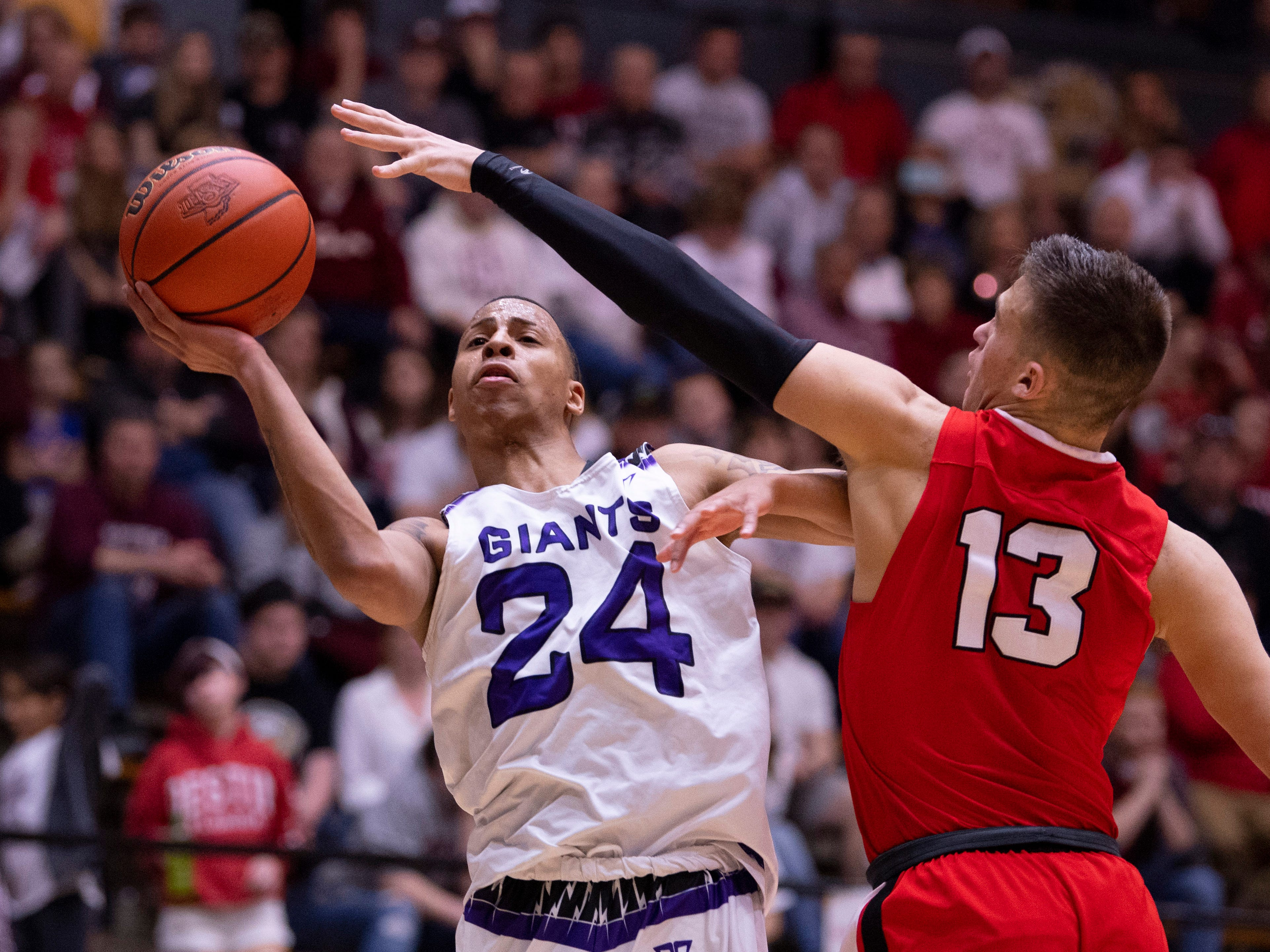 Ben Davis's Jalen Windham (24) shoots past Center Grove's Justin DeGraaf 13) during the 4A Boys Indiana Semi-State Basketball Tournament at the Hatchet House in Washington, Ind., Saturday afternoon.