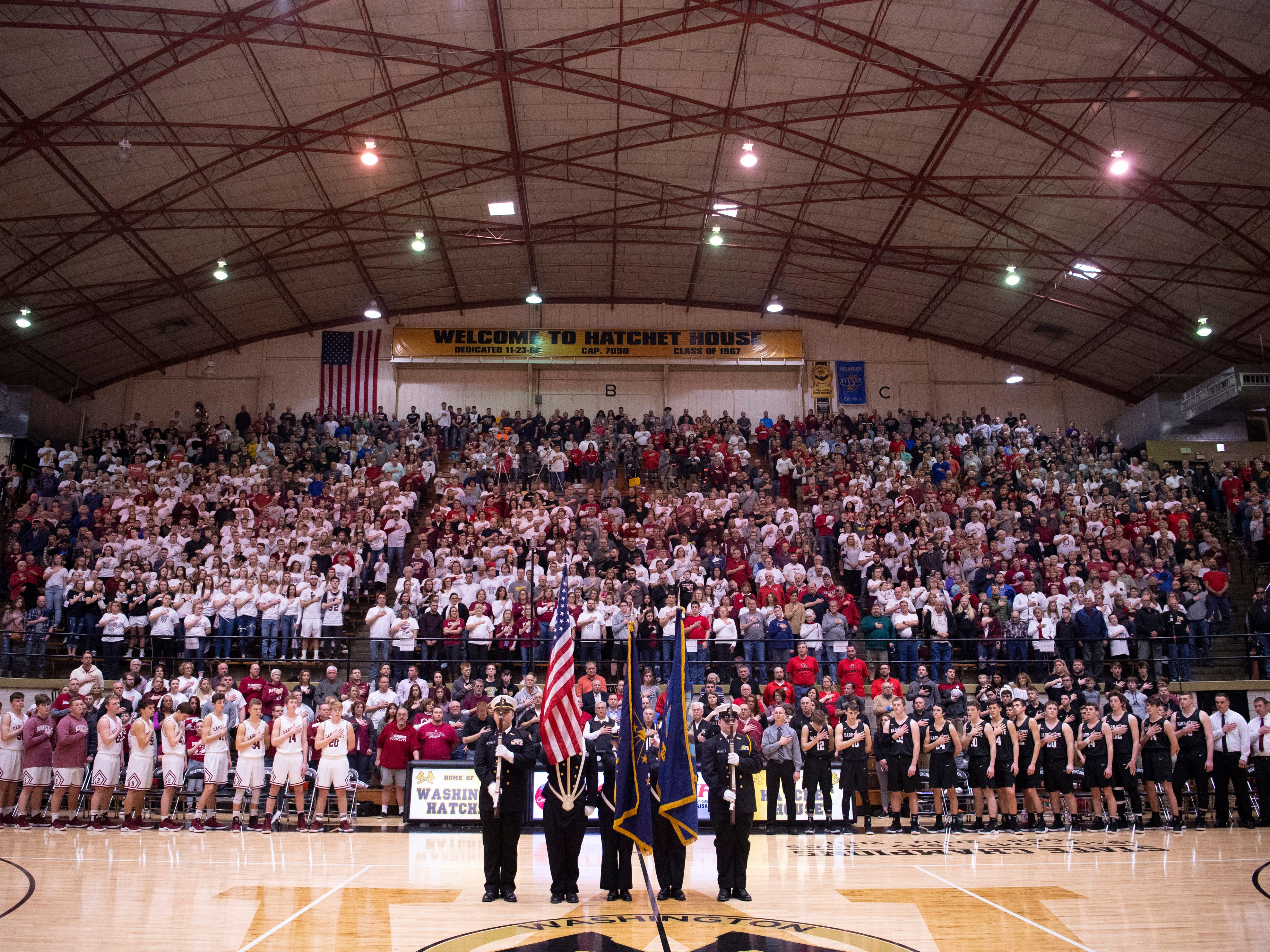 The Junior ROTC color guard displays the colors before the  start of the 1A Boys Indiana Semi-State Basketball Tournament at the Hatchet House in Washington, Ind., Saturday afternoon. Barr-Reeve beat Bloomfield to advance to the state championship game.