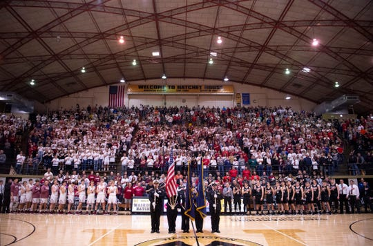 The Junior ROTC color guard displays the colors before the start of the 1A Boys Indiana Semi-State Basketball Tournament at the Hatchet House.