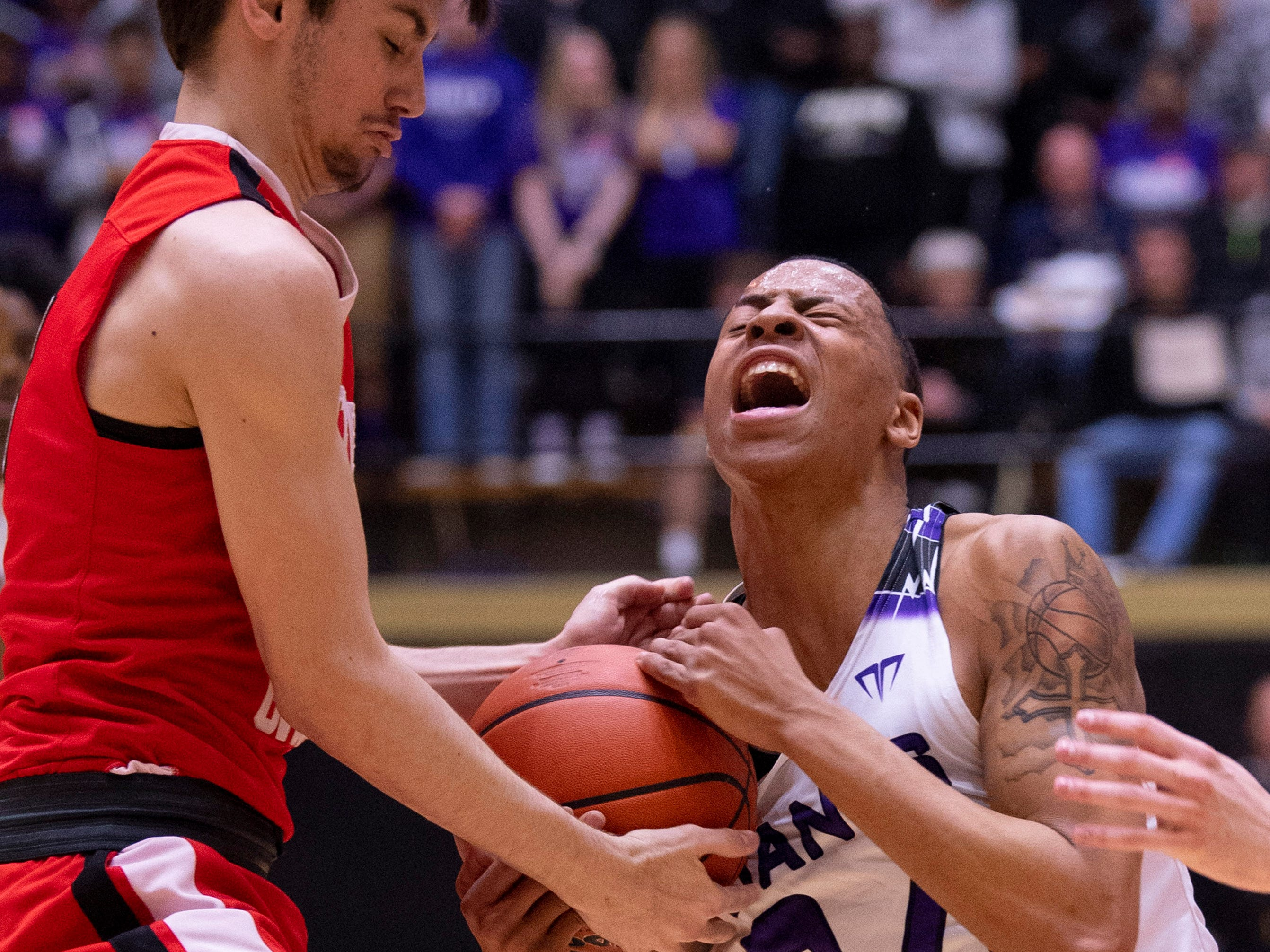 Ben Davis's Jalen Windham (24) is pressured by Center Grove's Ben Greller (3) during the 4A Boys Indiana Semi-State Basketball Tournament at the Hatchet House in Washington, Ind., Saturday afternoon.