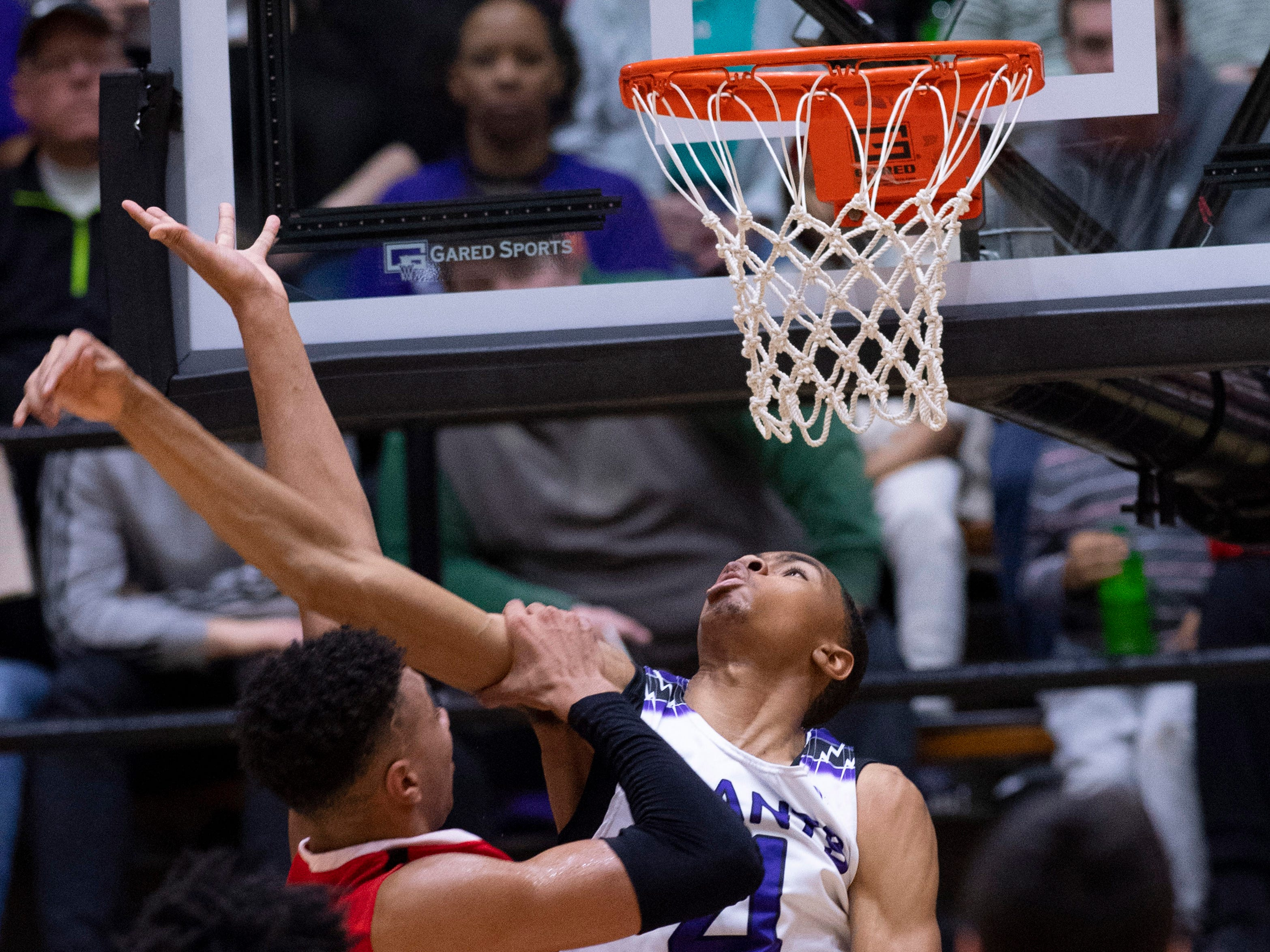 Center Grove's Trayce Jackson-Davis (23) grabs the arm of Ben Davis's Josh Shannon (4) after having his shot blocked during the 4A Boys Indiana Semi-State Basketball Tournament at the Hatchet House in Washington, Ind., Saturday afternoon. Shannon was called for the foul to his coach's dismay.