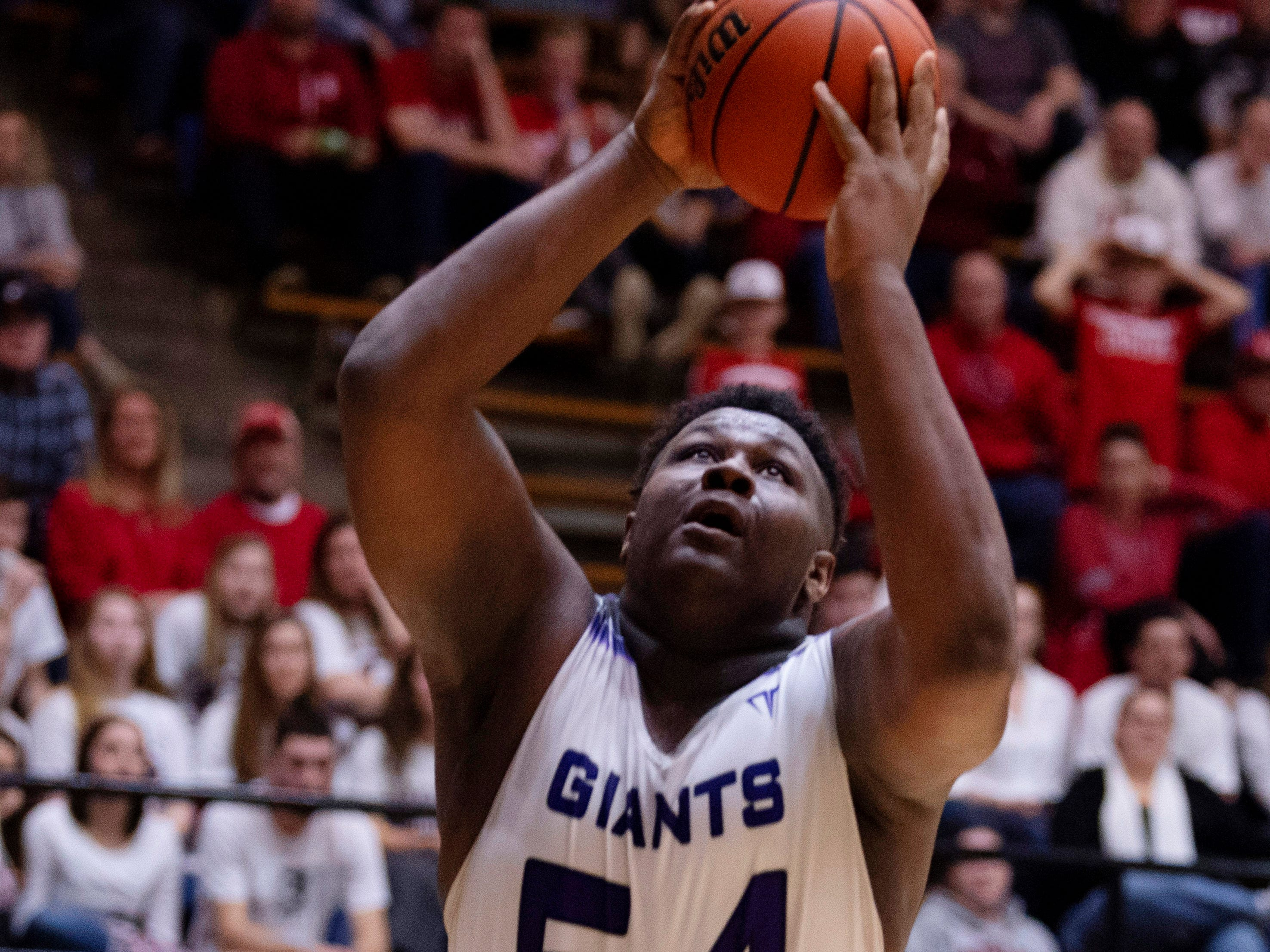 Ben Davis's Dawand Jones (54) puts in two points against  Center Grove during the 4A Boys Indiana Semi-State Basketball Tournament at the Hatchet House in Washington, Ind., Saturday afternoon.