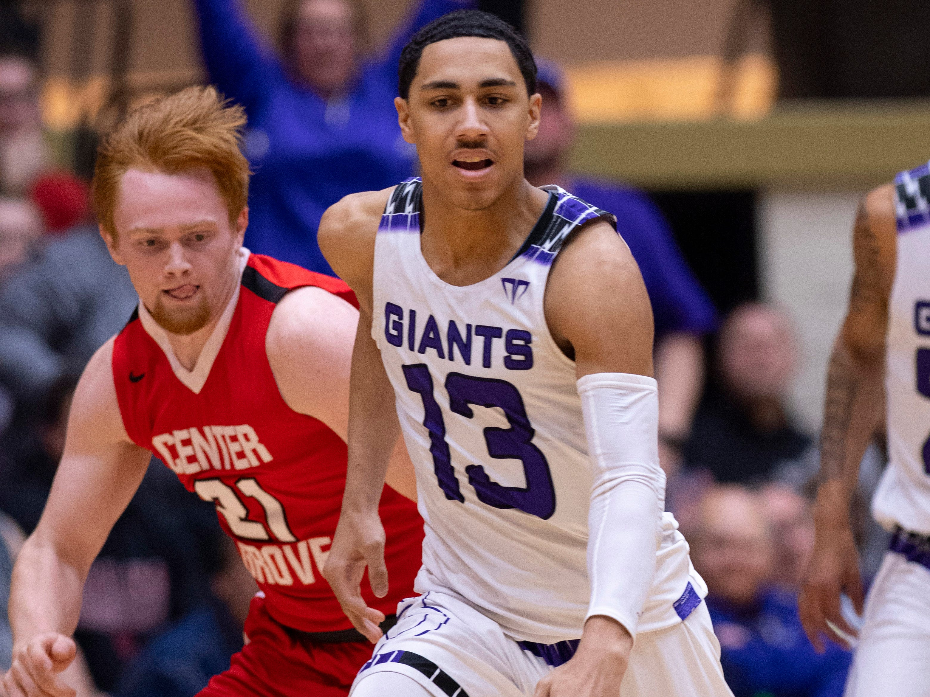 Ben Davis's Kai Hickman-Steinman (13) brings the ball across the timeline before getting it stripped by Center Grove's Cameron Petty (21) during the 4A Boys Indiana Semi-State Basketball Tournament at the Hatchet House in Washington, Ind., Saturday afternoon.