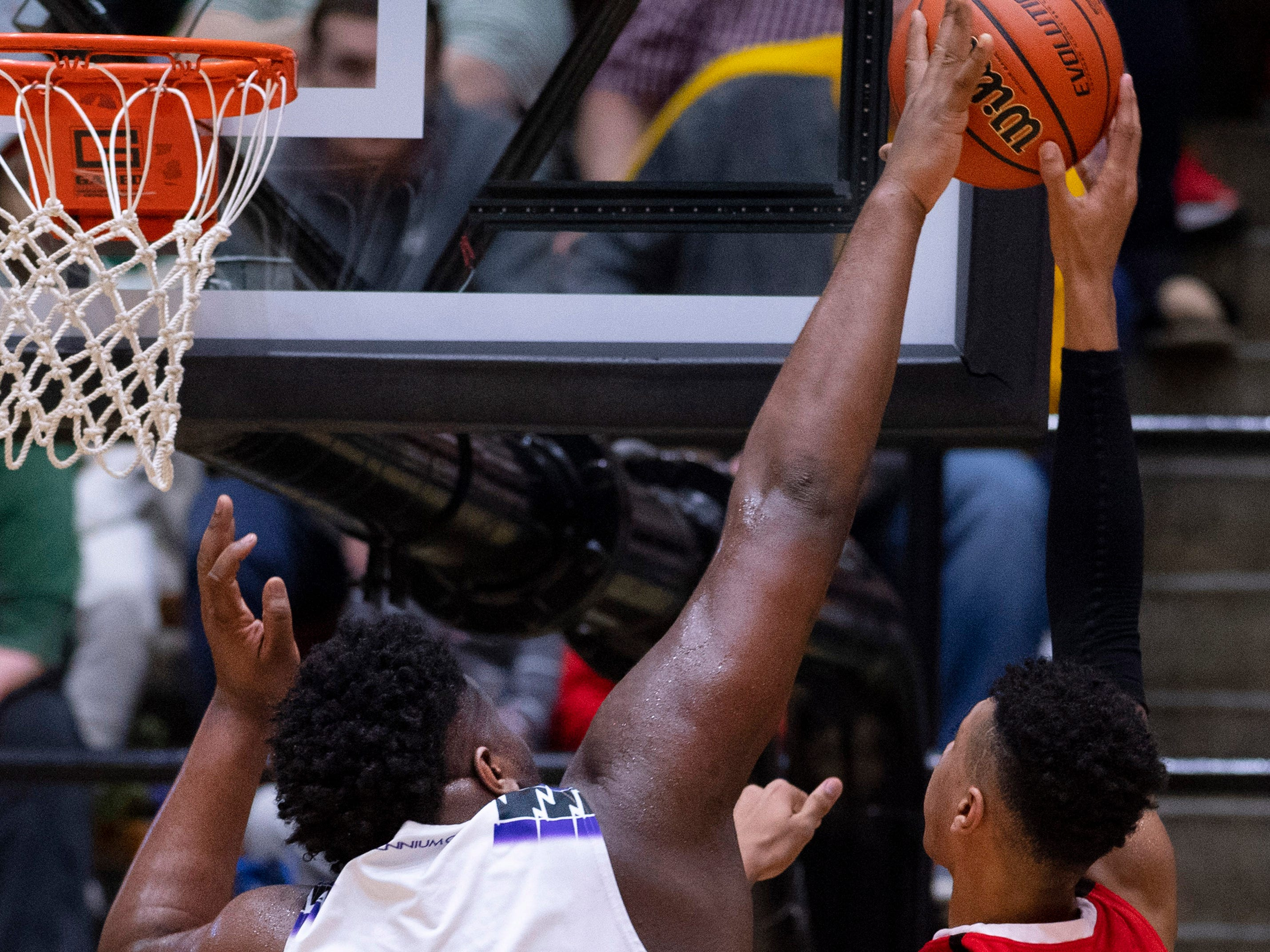 Ben Davis's Dawand Jones (54) rejects the shot of Center Grove's Trayce Jackson-Davis (23) during the 4A Boys Indiana Semi-State Basketball Tournament at the Hatchet House in Washington, Ind., Saturday afternoon.
