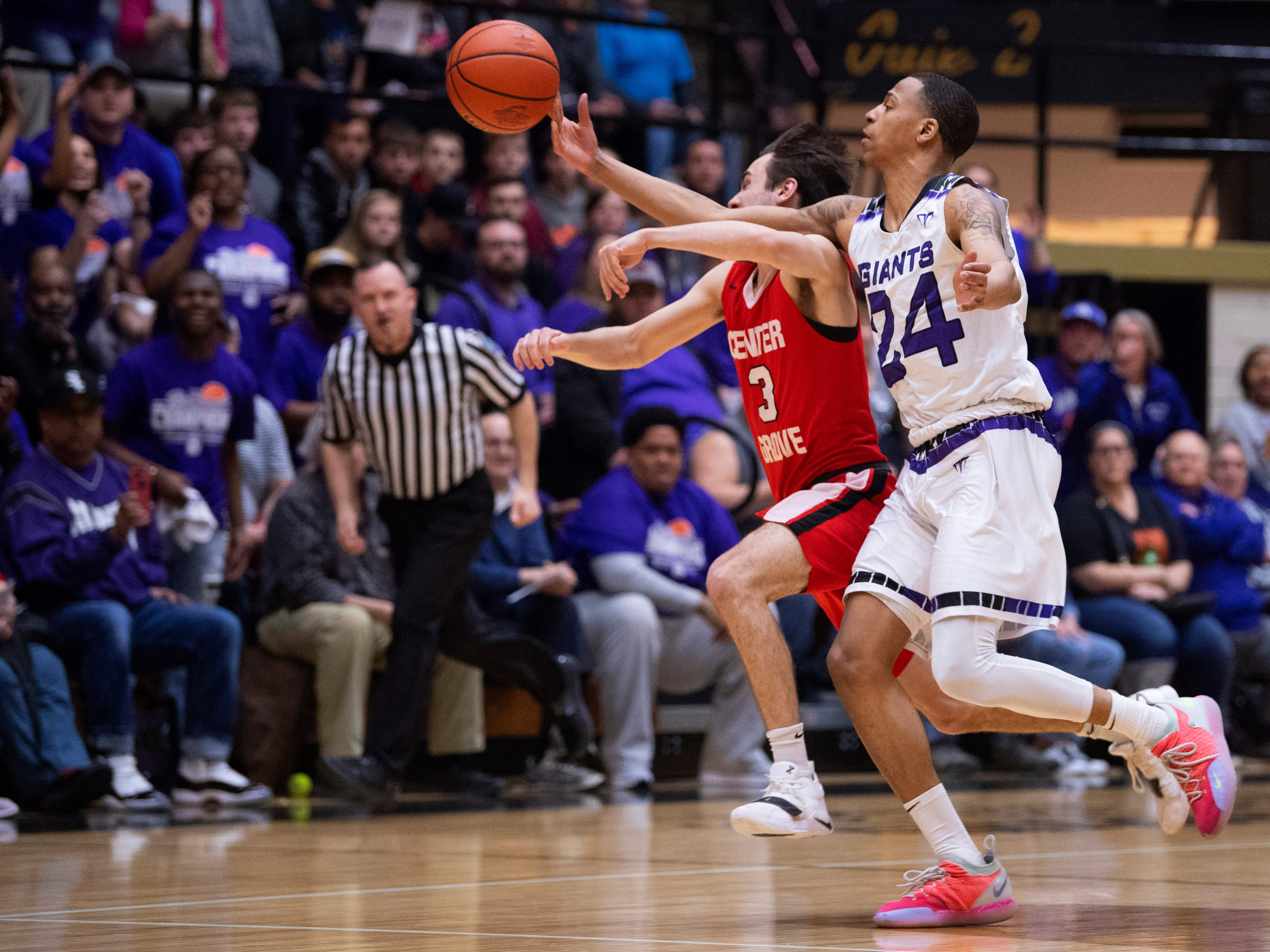 Ben Davis's Jalen Windham (24) gets to the ball a little quicker than Center Grove's Ben Greller (3) during the 4A Boys Indiana Semi-State Basketball Tournament at the Hatchet House in Washington, Ind., Saturday afternoon.