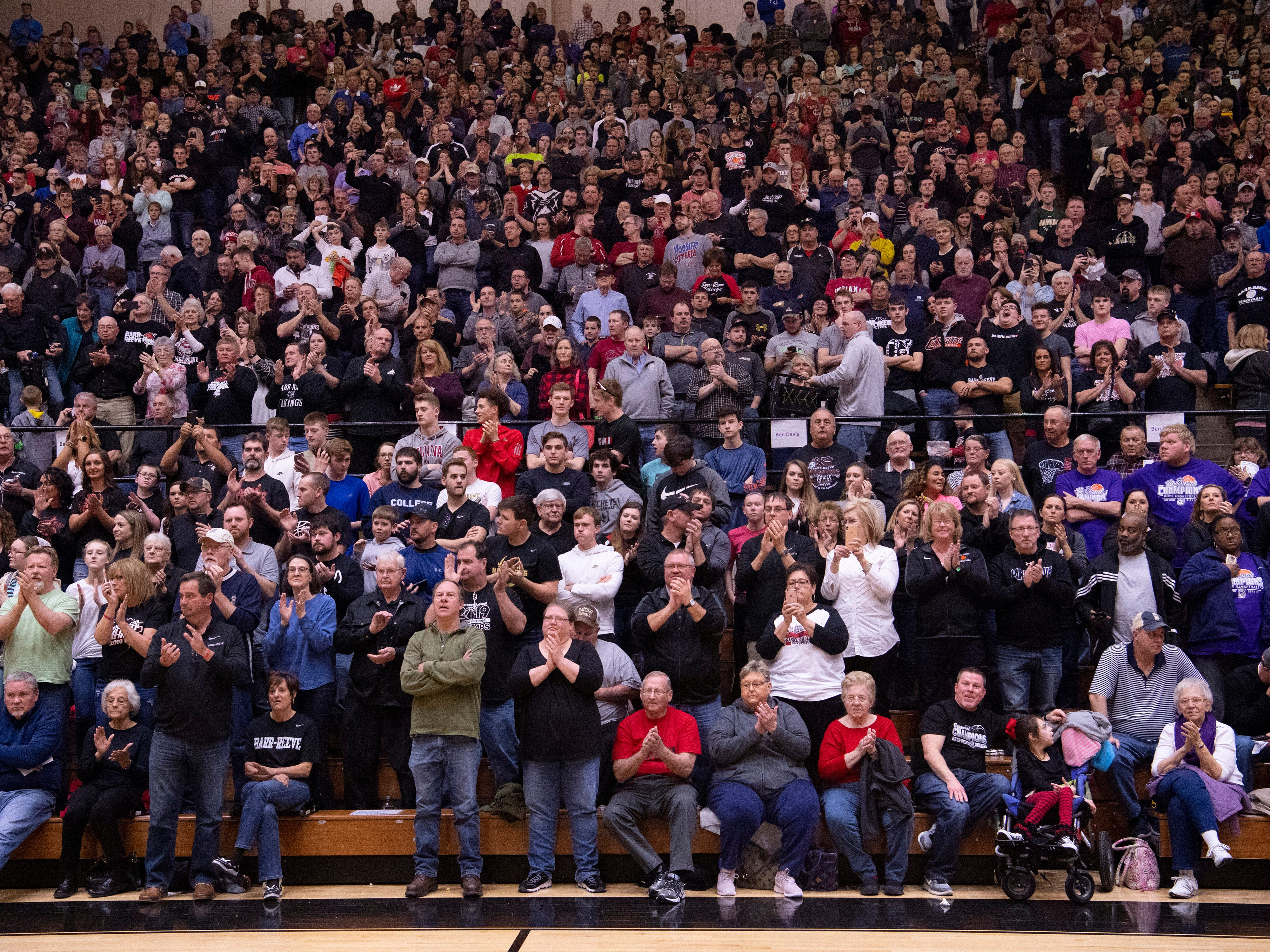 Barr-Reeve's fans cheer them after they beat Bloomfield at the 1A Boys Indiana Semi-State Basketball Tournament at the Hatchet House in Washington, Ind., Saturday afternoon.
