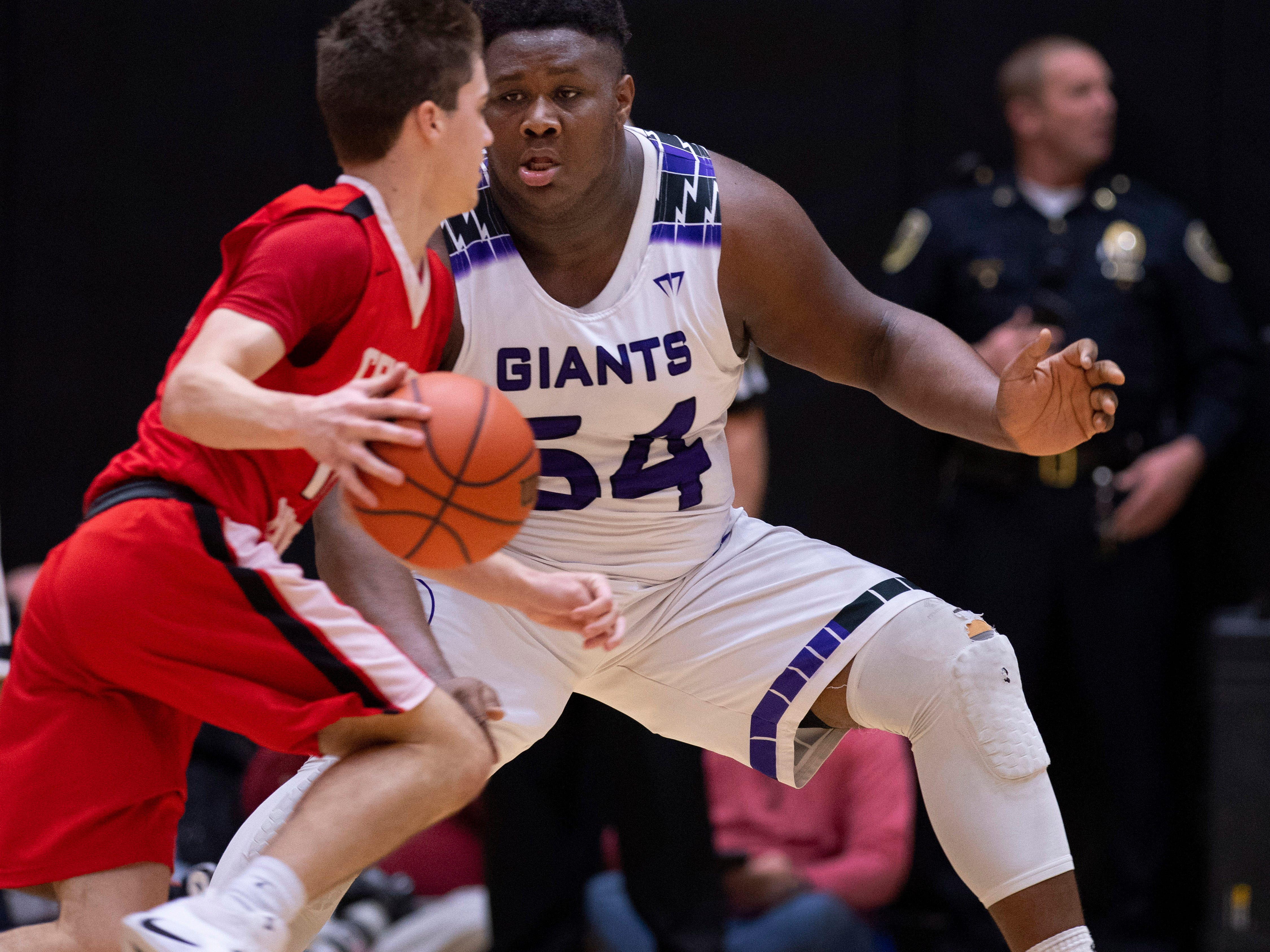 Center Grove's Spencer Piercefield (10) is defended by Ben Davis's Dawand Jones (54) during the 4A Boys Indiana Semi-State Basketball Tournament at the Hatchet House in Washington, Ind., Saturday afternoon.