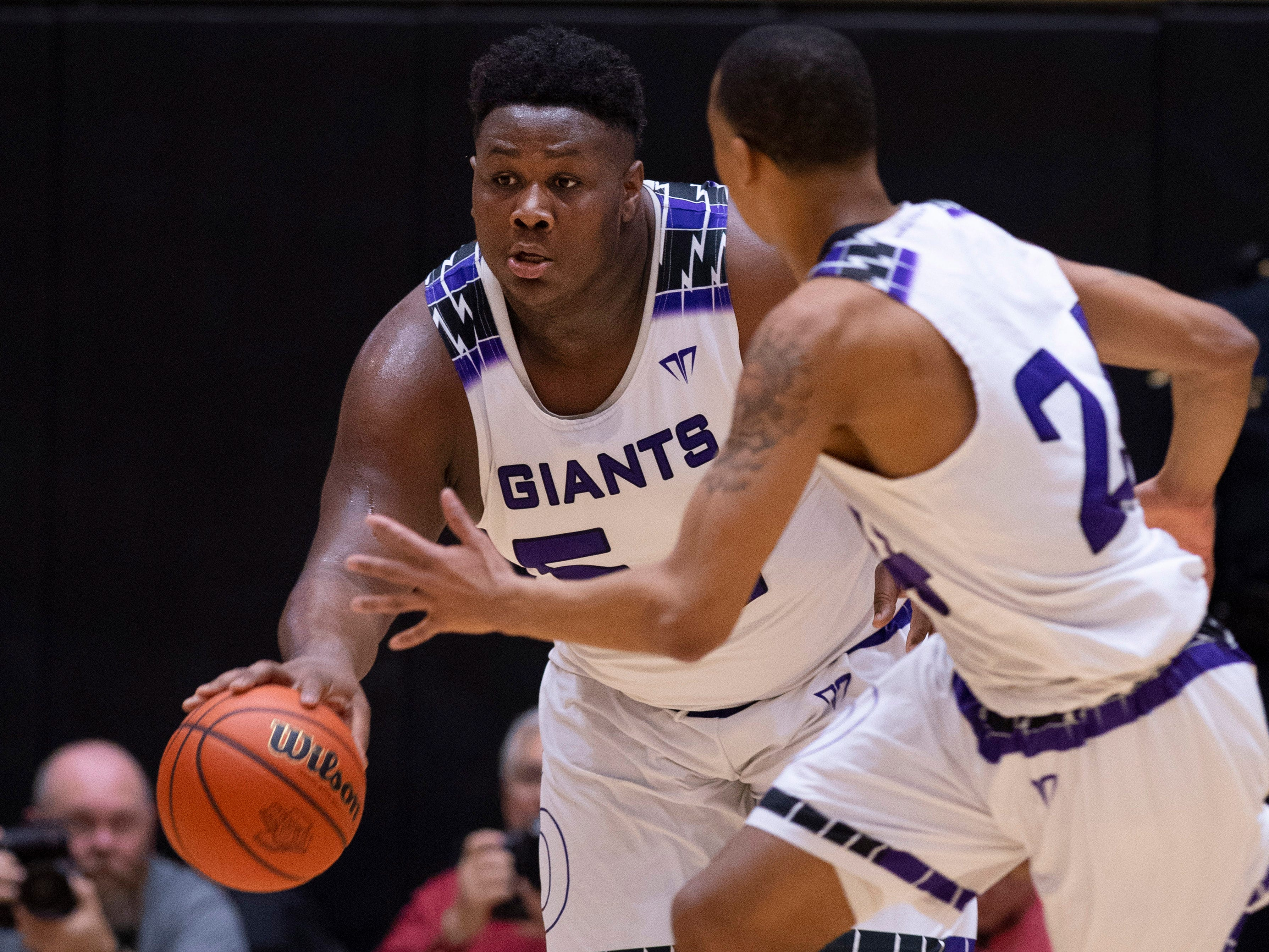 Ben Davis's Dawand Jones (54) brings the ball up court after grabbing a rebound against Center Grove during the 4A Boys Indiana Semi-State Basketball Tournament at the Hatchet House in Washington, Ind., Saturday afternoon.