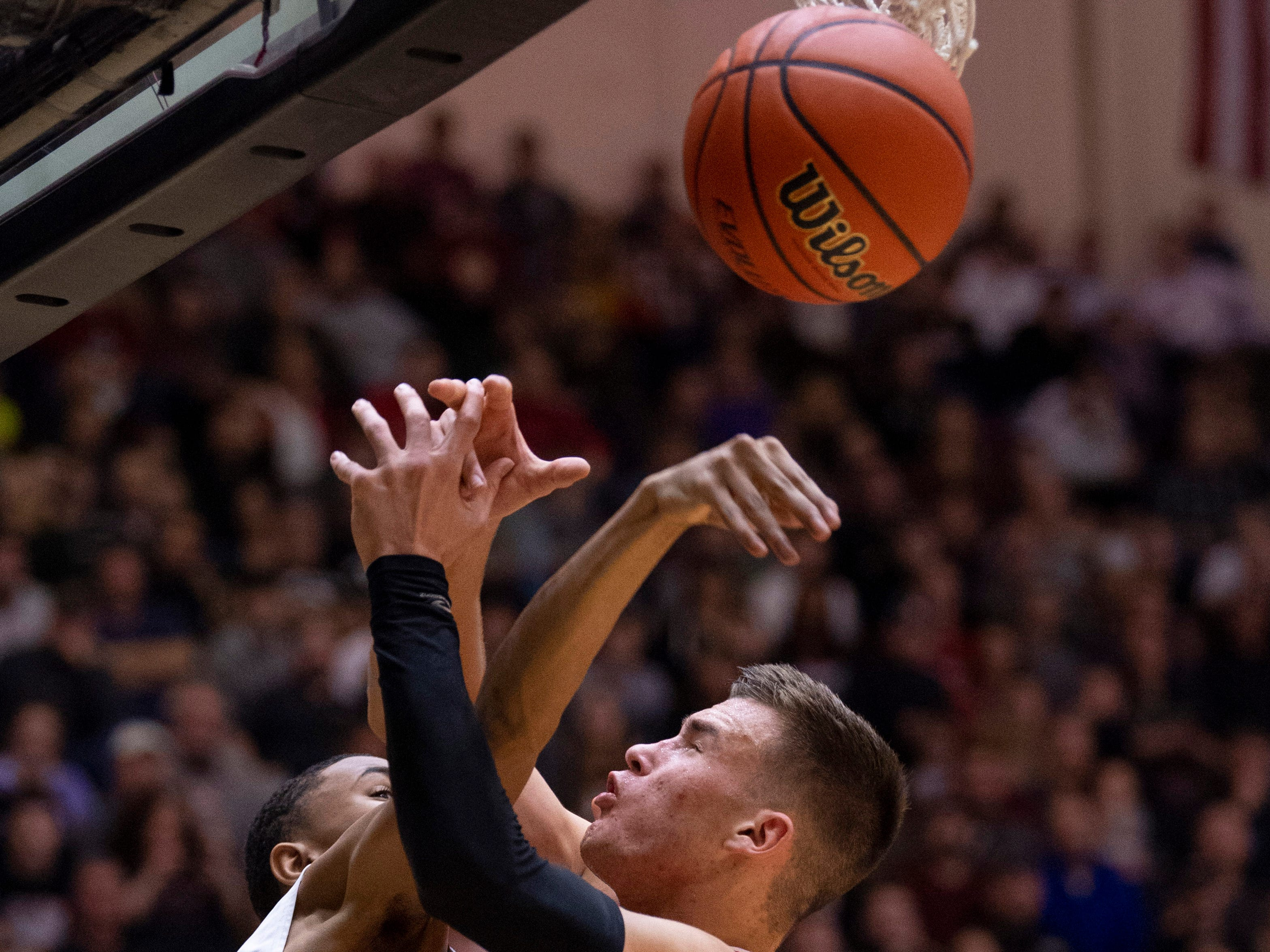 Ben Davis's Josh Shannon (4) blocks the shot of Center Grove's Justin DeGraaf (13) during the 4A Boys Indiana Semi-State Basketball Tournament at the Hatchet House in Washington, Ind., Saturday afternoon.
