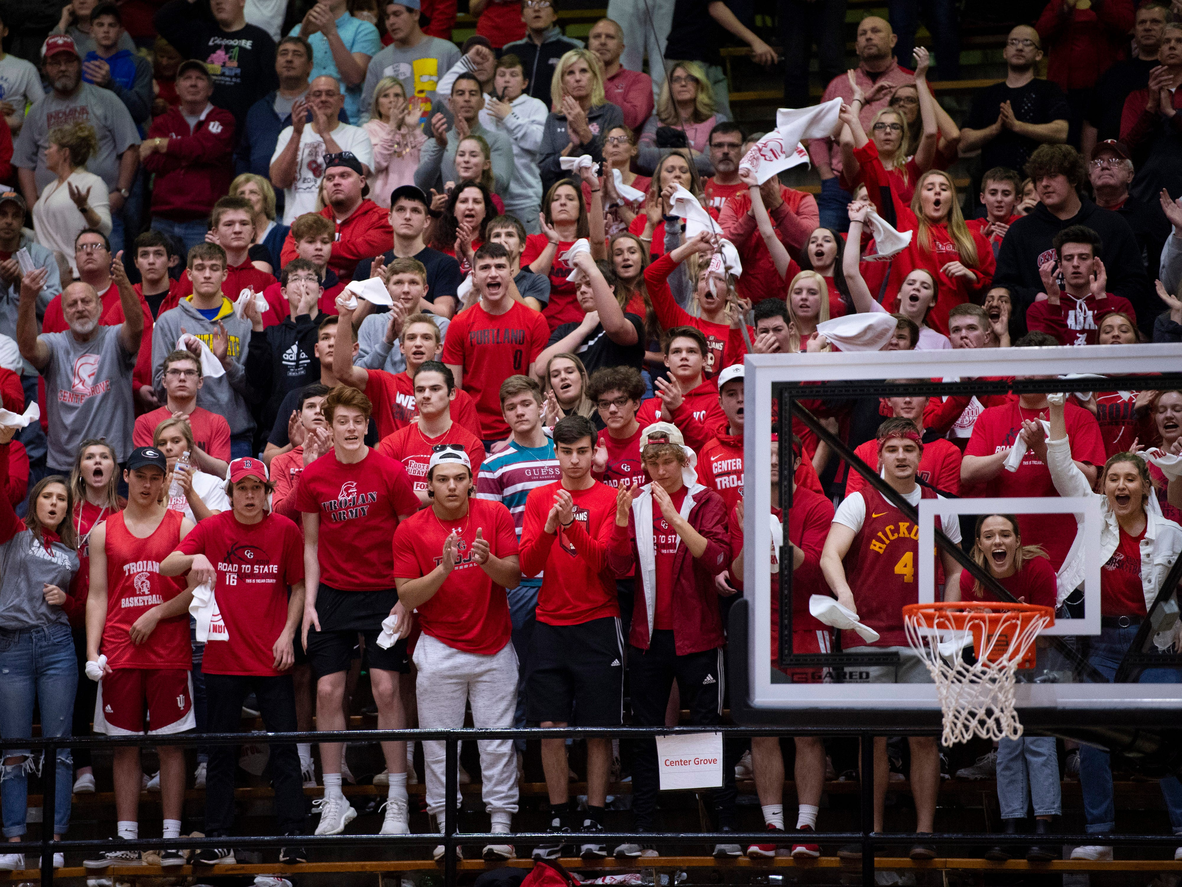 Central Grove's student section celebrates their team's comeback against Ben Davis during the 4A Boys Indiana Semi-State Basketball Tournament at the Hatchet House in Washington, Ind., Saturday afternoon. They were down 15 points with about six minutes to go and eventually cut the lead down to five before eventually losing.