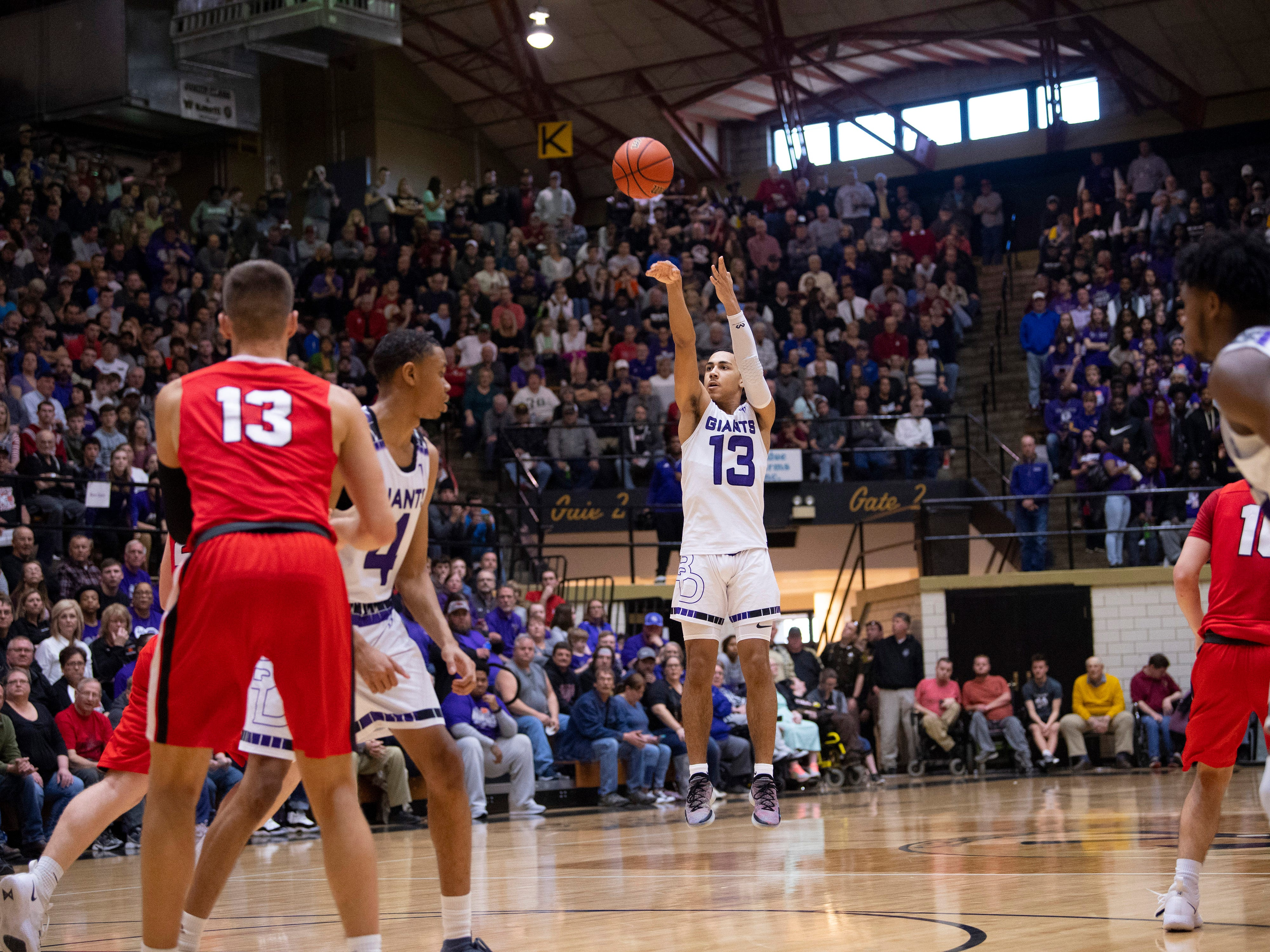 Ben Davis's Kai Hickman-Steinman (13) puts up a three-pointer against Center grove during the 4A Boys Indiana Semi-State Basketball Tournament at the Hatchet House in Washington, Ind., Saturday afternoon.