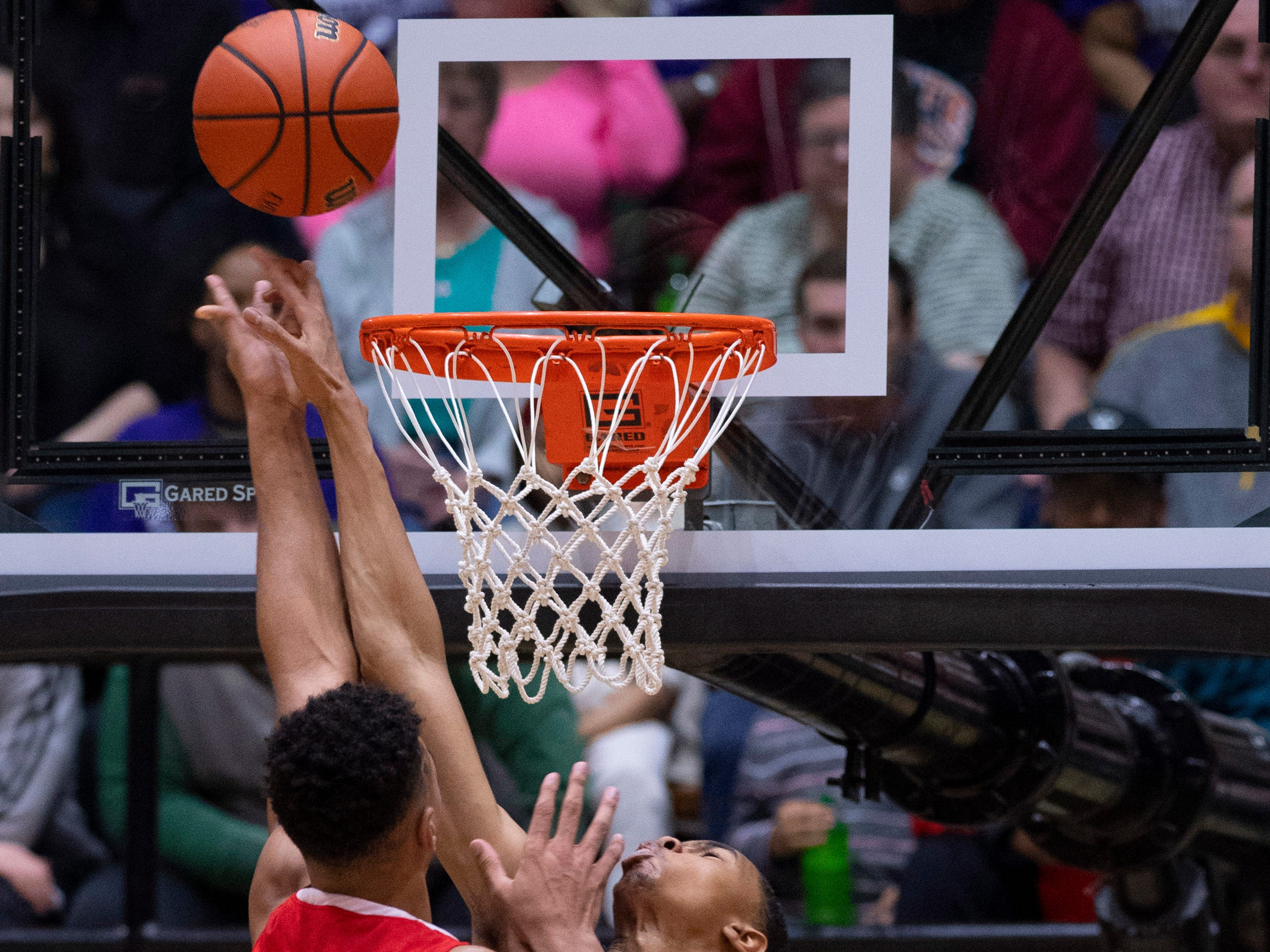 Ben Davis's Josh Shannon (4) blocks the shot of Center Grove's Trayce Jackson-Davis (23) during the 4A Boys Indiana Semi-State Basketball Tournament at the Hatchet House in Washington, Ind., Saturday afternoon.
