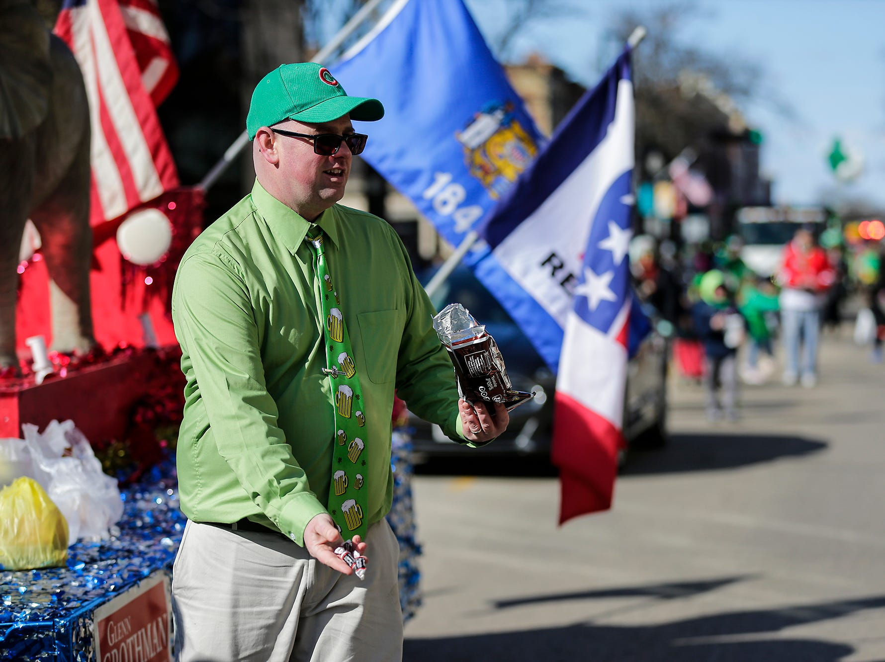 Rohn Bishop of Waupun throws out candy while walking with the Republican Party of Fond du Lac County in the City of Fond du Lac St. Patrick's Day Parade Saturday, March 16, 2019 on Main Street in downtown Fond du Lac. Hundreds of people lined the street to watch over 50 parade participants. Doug Raflik/USA TODAY NETWORK-Wisconsin