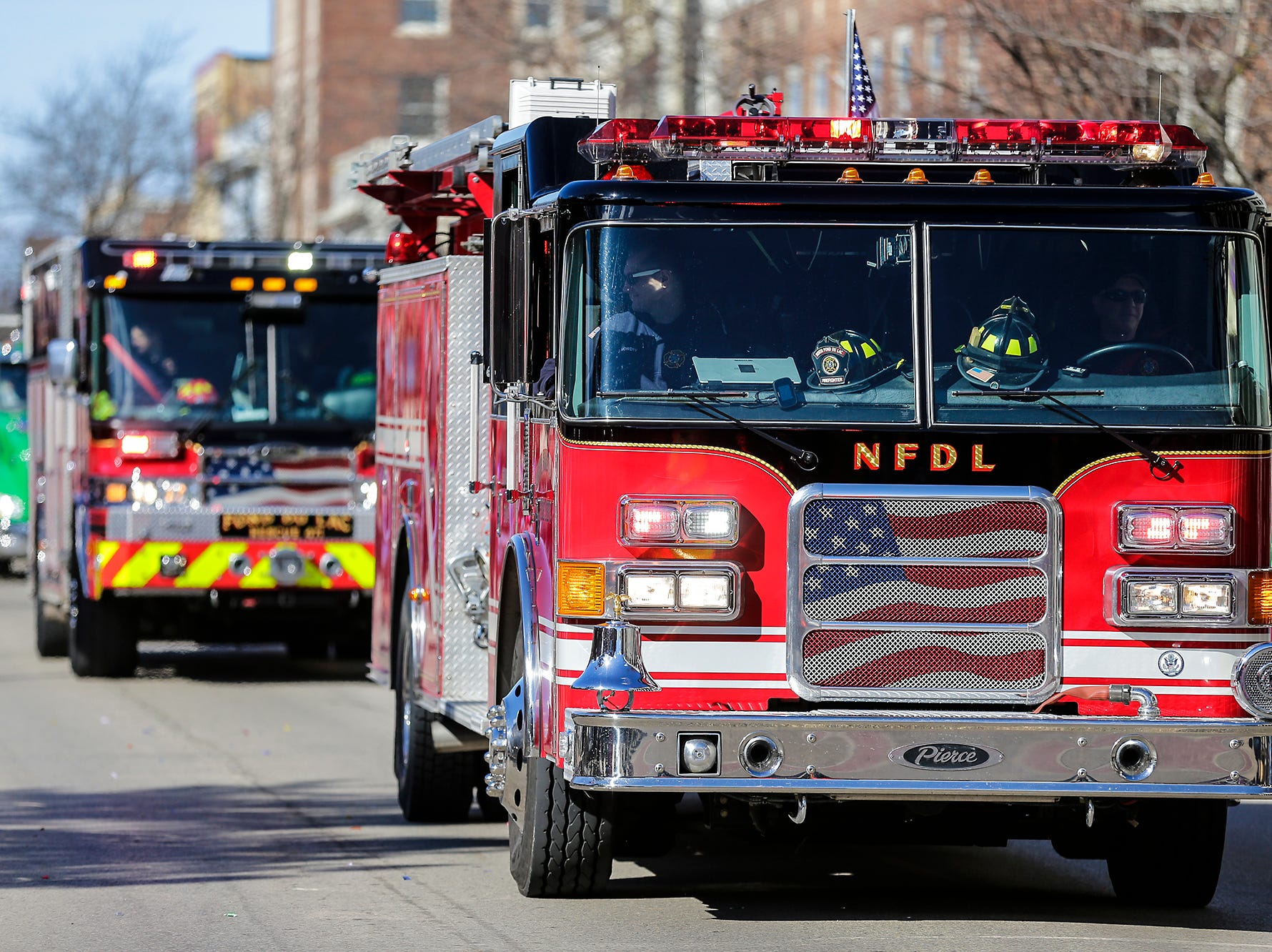North Fond du Lac and Fond du Lac Fire Departments participated in the City of Fond du Lac St. Patrick's Day Parade Saturday, March 16, 2019 on Main Street in downtown Fond du Lac. Hundreds of people lined the street to watch over 50 parade participants. Doug Raflik/USA TODAY NETWORK-Wisconsin