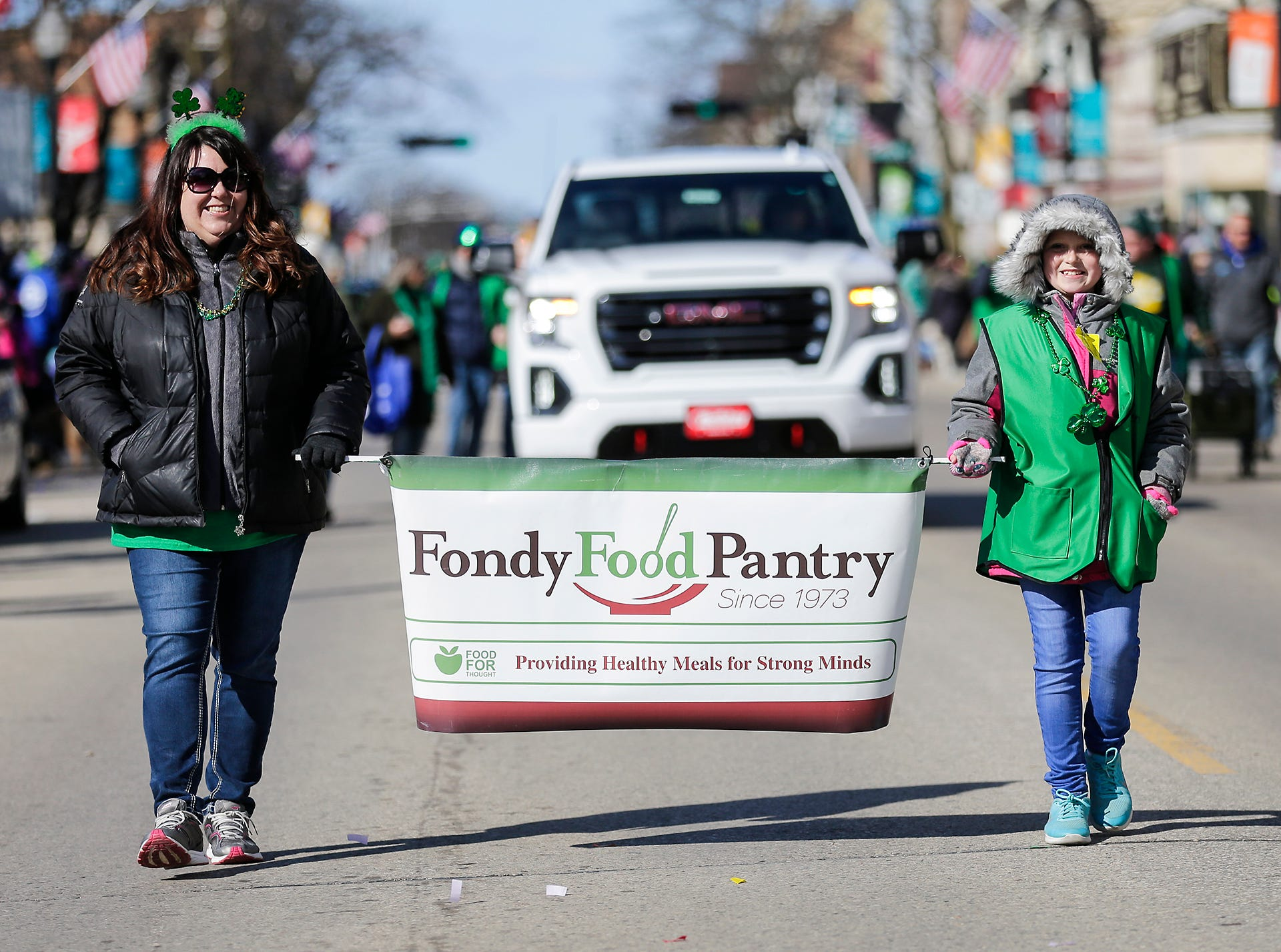 Staci and Emma Polishinski participated in the City of Fond du Lac St. Patrick's Day Parade for the Fondy Food Pantry Saturday, March 16, 2019 on Main Street in downtown Fond du Lac. Hundreds of people lined the street to watch over 50 parade participants. Doug Raflik/USA TODAY NETWORK-Wisconsin