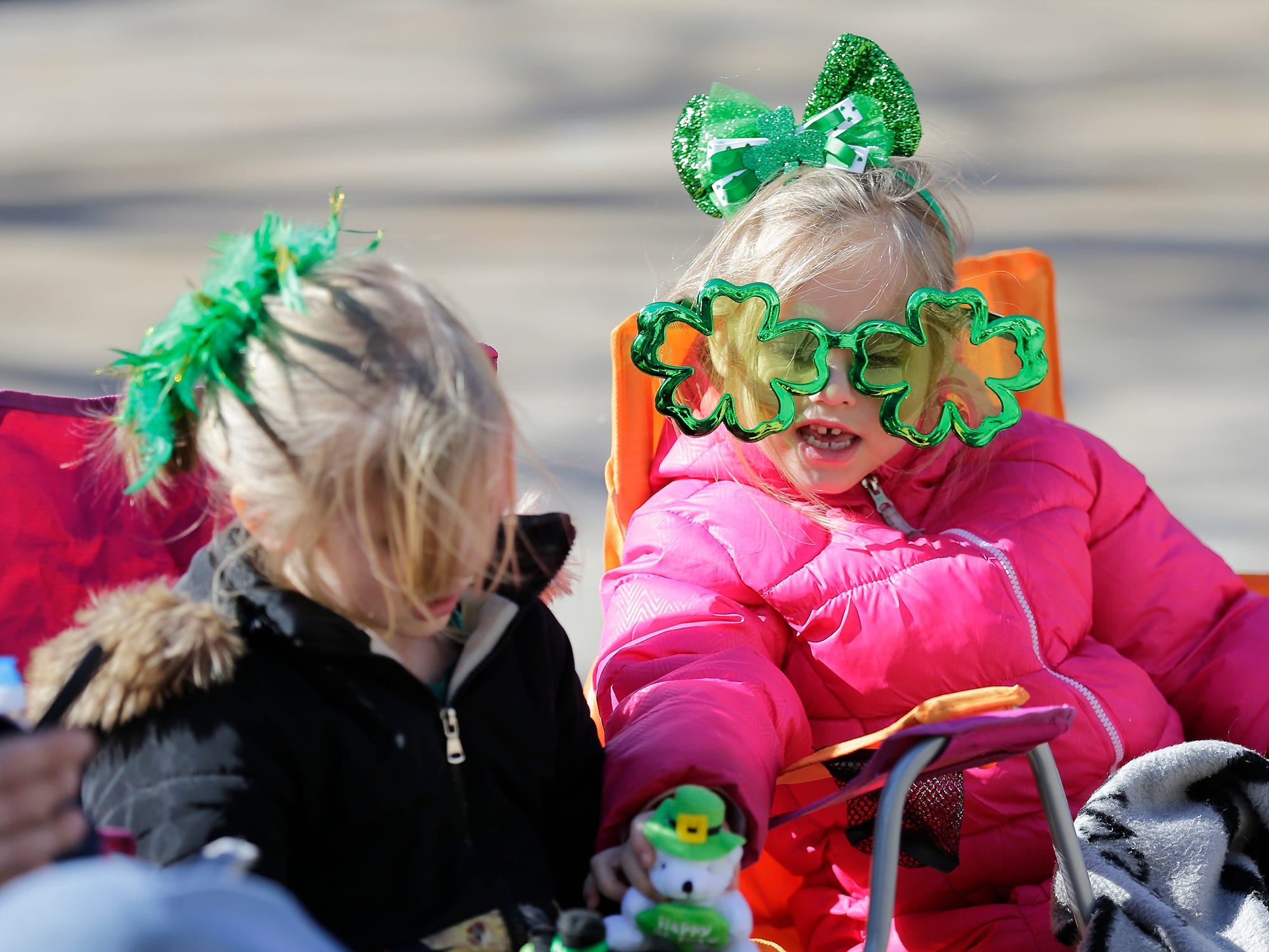 Trinity Seager and Storm Smith play as they wait for the City of Fond du Lac St. Patrick's Day Parade Saturday, March 16, 2019 on Main Street in downtown Fond du Lac. Hundreds of people lined the street to watch over 50 parade participants. Doug Raflik/USA TODAY NETWORK-Wisconsin