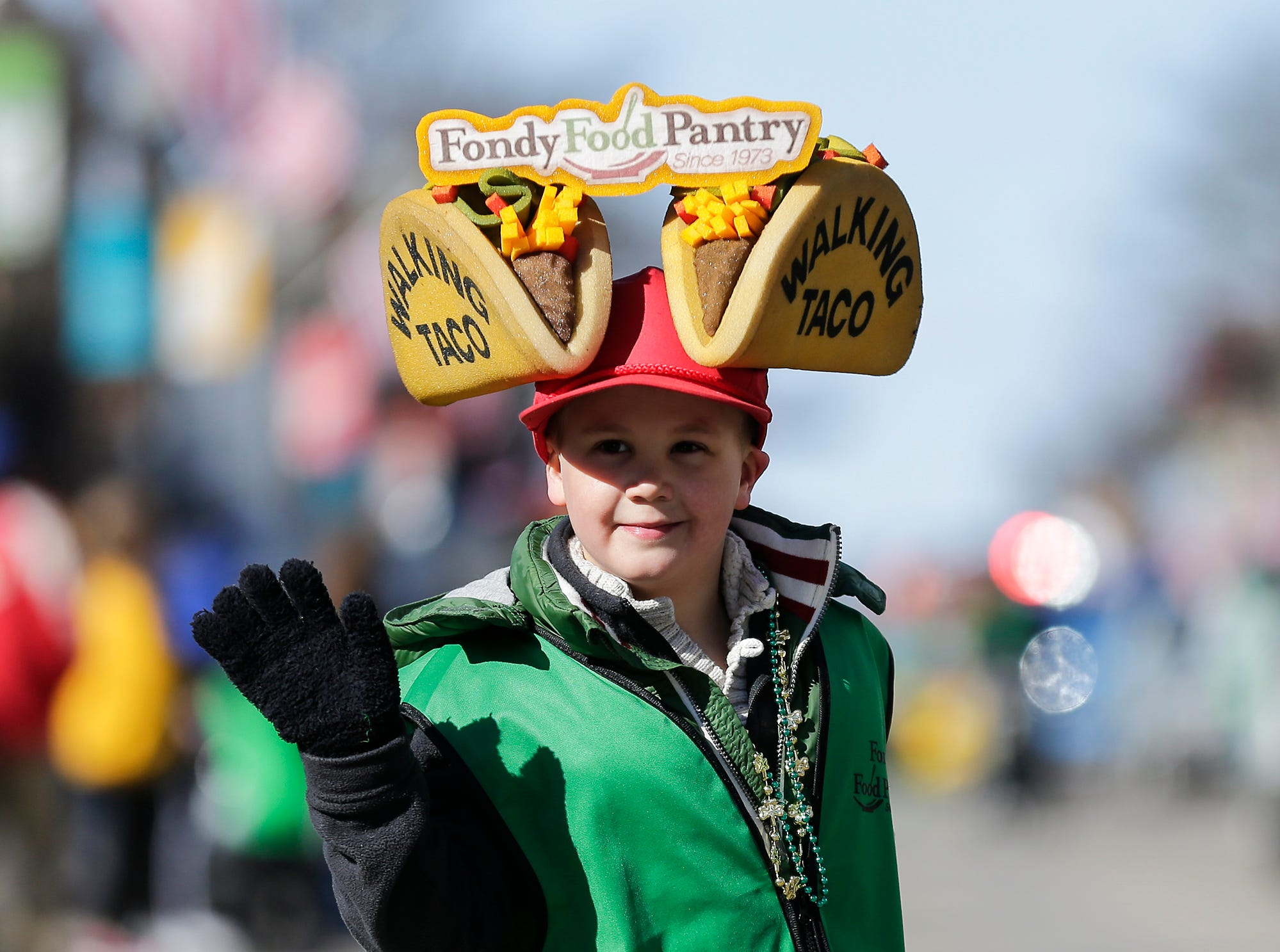 Kaden Olig waves to parade watchers as he walks in the City of Fond du Lac St. Patrick's Day Parade Saturday, March 16, 2019 on Main Street in downtown Fond du Lac. Hundreds of people lined the street to watch over 50 parade participants. Doug Raflik/USA TODAY NETWORK-Wisconsin