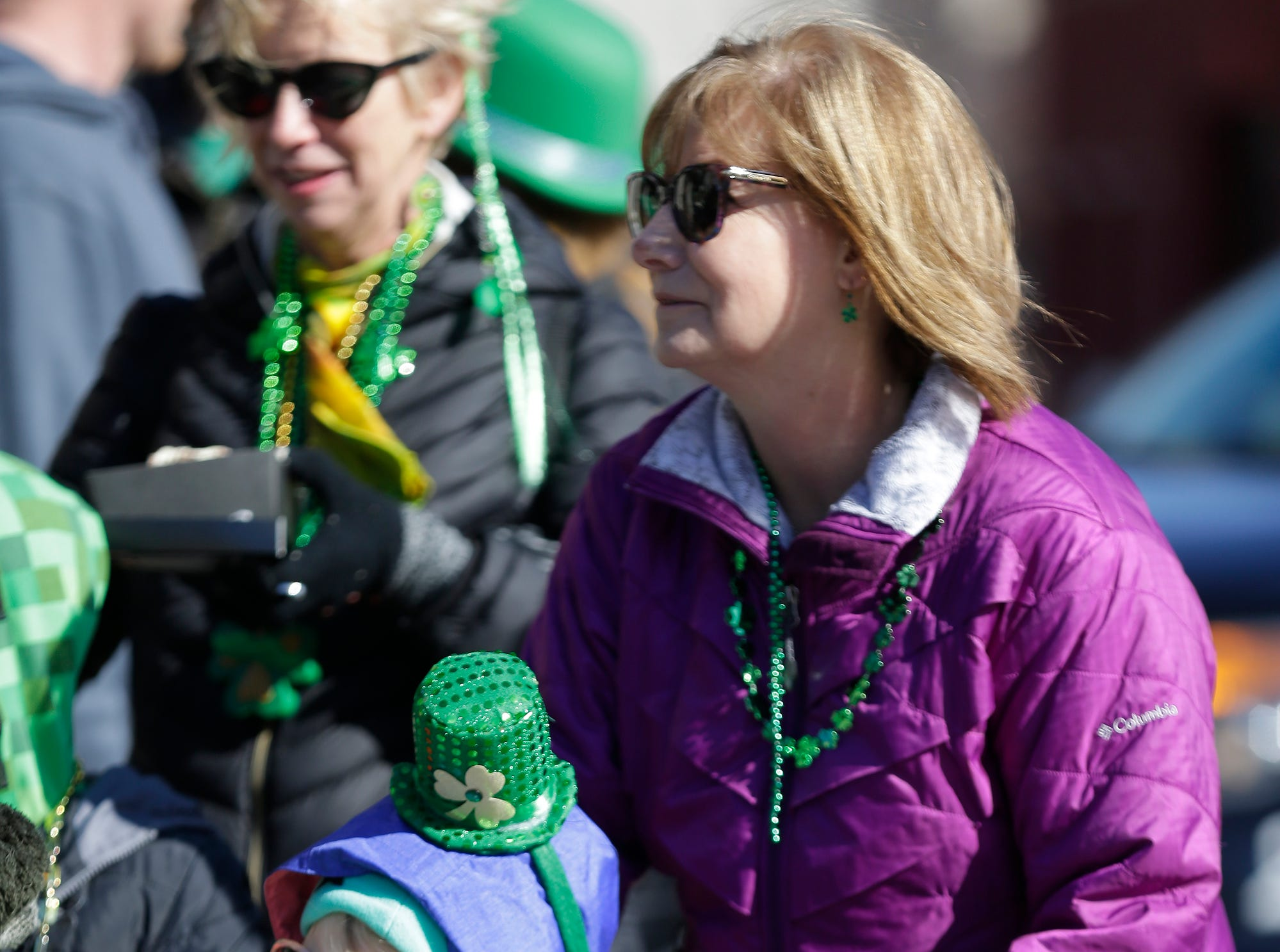 Jada Resop and Renee Lesa of Fond du Lac watch the City of Fond du Lac St. Patrick's Day Parade Saturday, March 16, 2019 on Main Street in downtown Fond du Lac. Hundreds of people lined the street to watch over 50 parade participants. Doug Raflik/USA TODAY NETWORK-Wisconsin