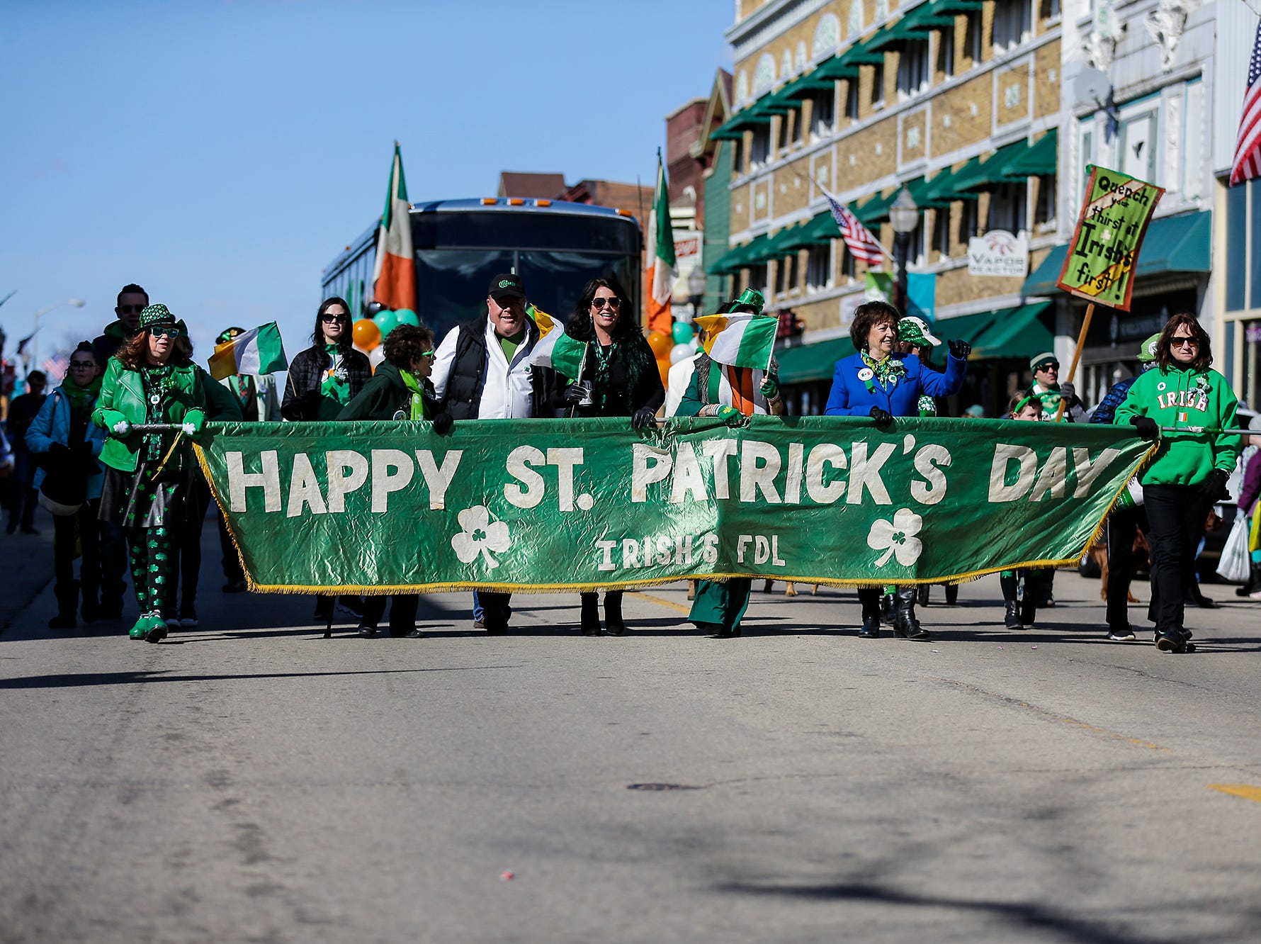 A group of people hold a banner for Irish's Bar in the City of Fond du Lac St. Patrick's Day Parade Saturday, March 16, 2019 on Main Street in downtown Fond du Lac. Hundreds of people lined the street to watch over 50 parade participants. Doug Raflik/USA TODAY NETWORK-Wisconsin