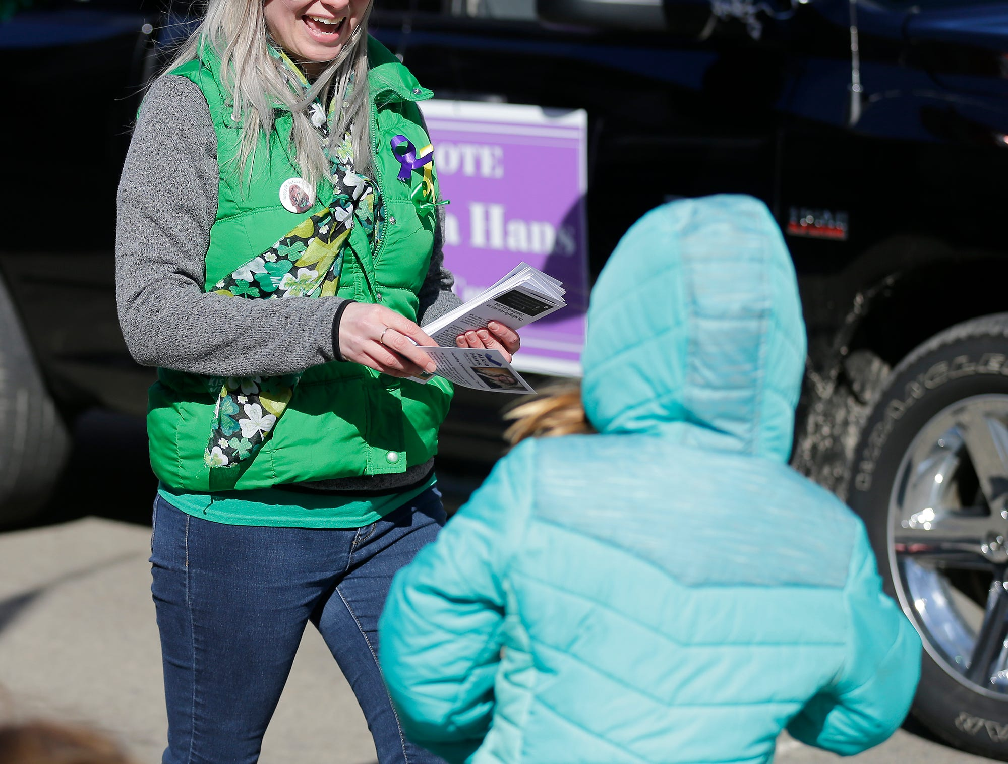 Alicia Hans hands out flyers for her city council candidacy in the City of Fond du Lac St. Patrick's Day Parade Saturday, March 16, 2019 on Main Street in downtown Fond du Lac. Hundreds of people lined the street to watch over 50 parade participants. Doug Raflik/USA TODAY NETWORK-Wisconsin